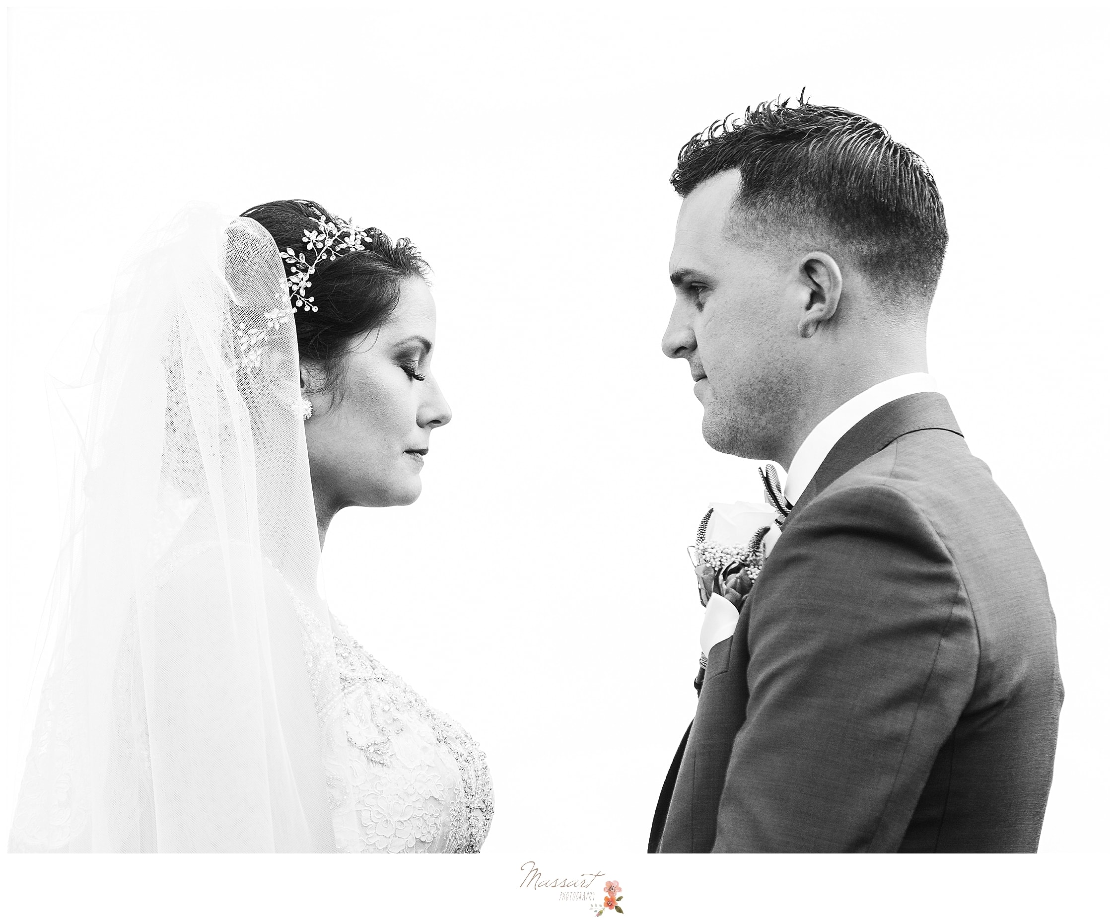 Emotional moment between bride and groom at Rhode Island venue Harbor Lights photographed by wedding photographers Massart Photography.