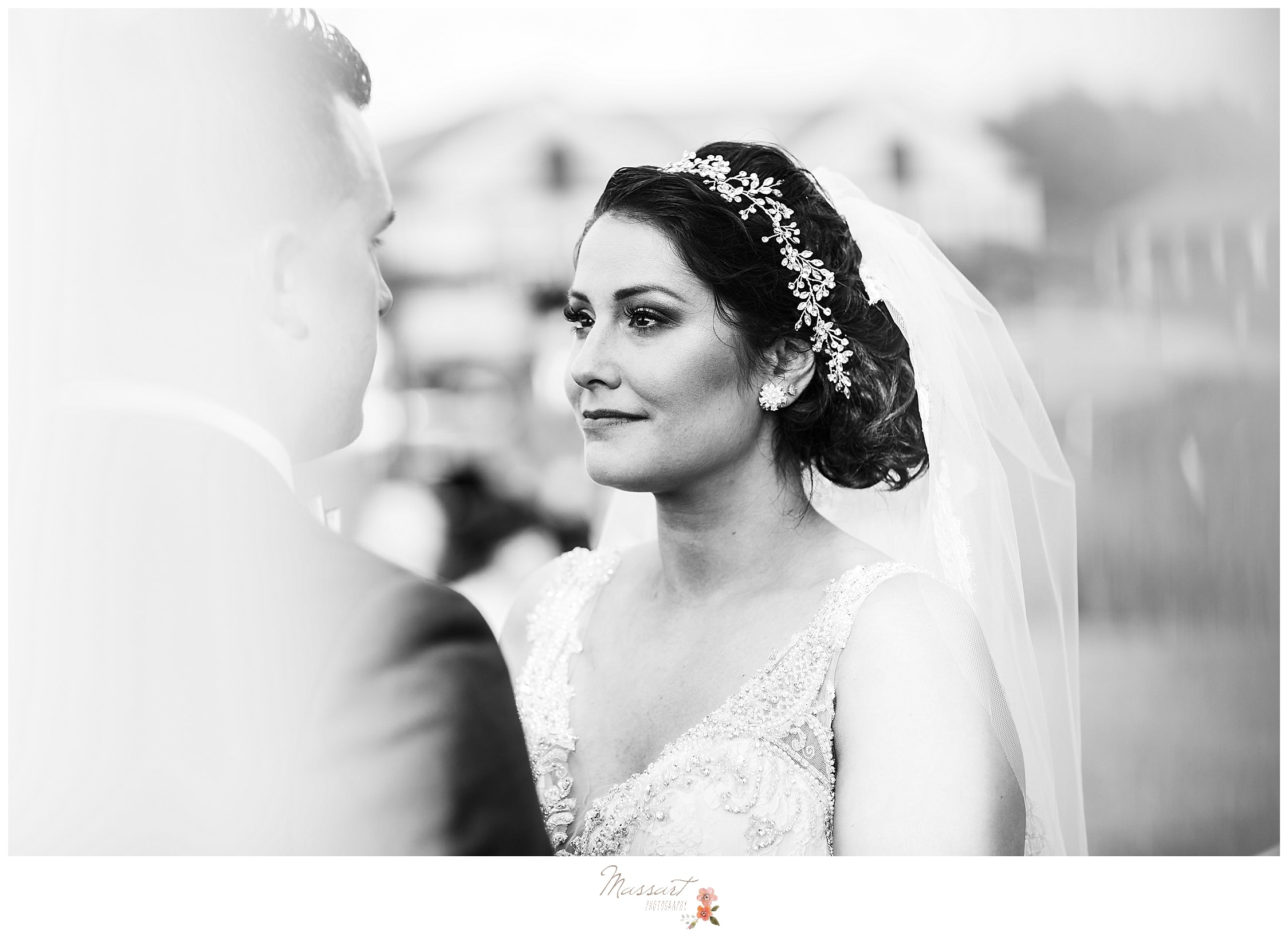 Bride and groom during vows at Harbor Lights in RI photographed by Rhode Island wedding photographers Massart Photography.