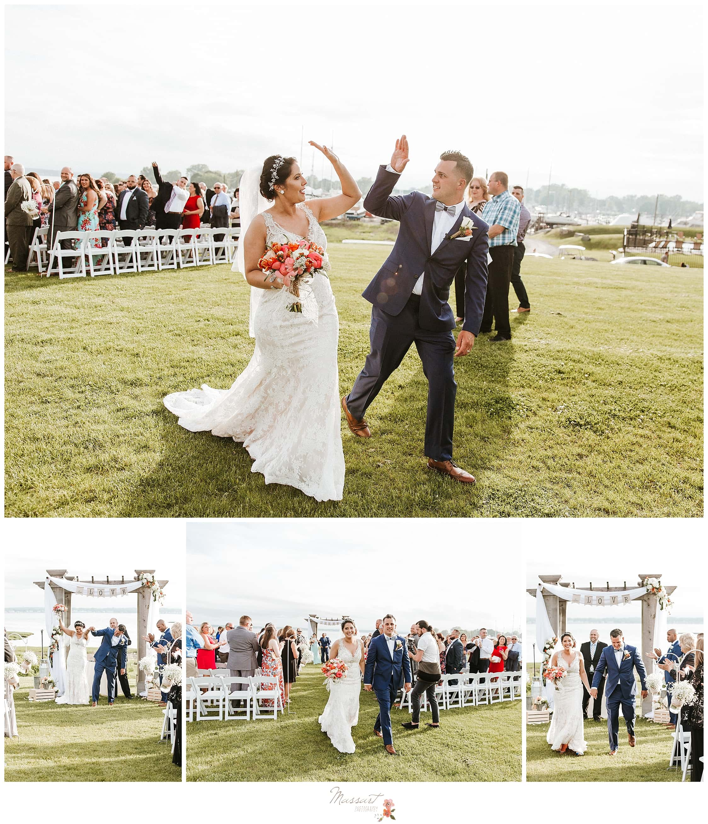 Bride and groom high fiving after wedding ceremony at Harbor Lights in RI photographed by CT and MA wedding photographers Massart Photography.