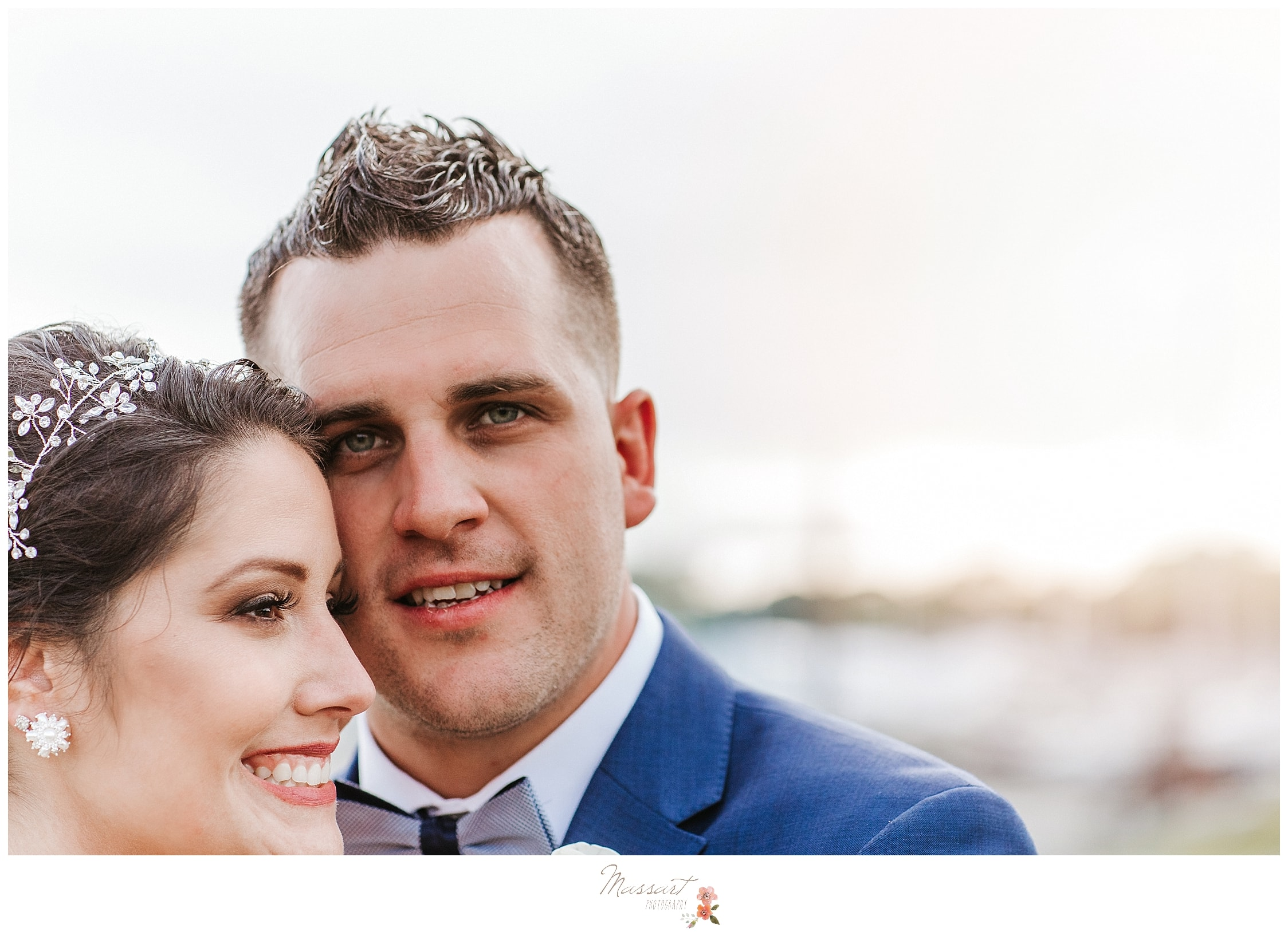 Groom and his new wife at Harbor Lights photographed by Rhode Island wedding photographer Massart Photography.