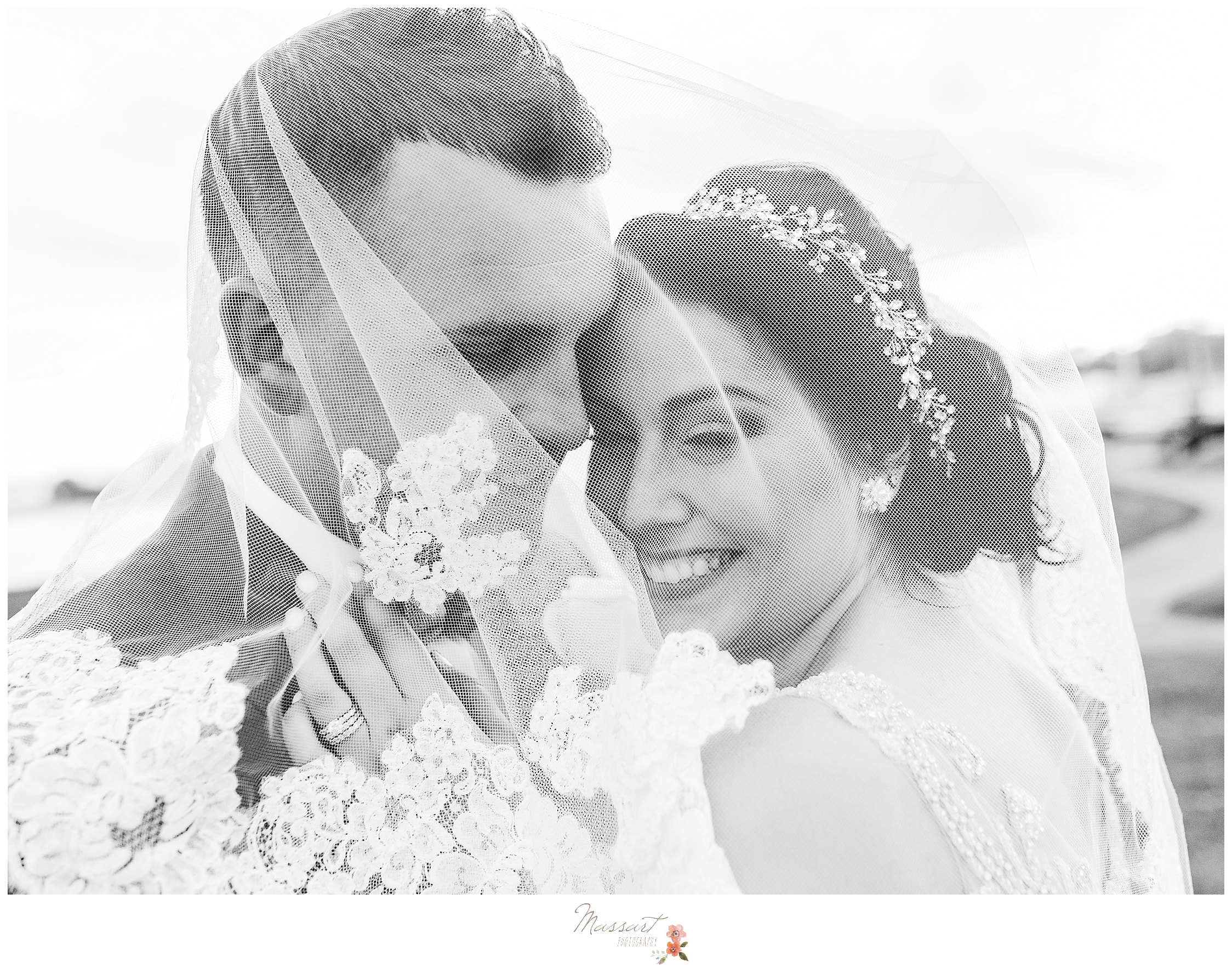 Bride and groom laughing during wedding porraits at Harbor Lights photographed by RI wedding photographers Massart Photography.