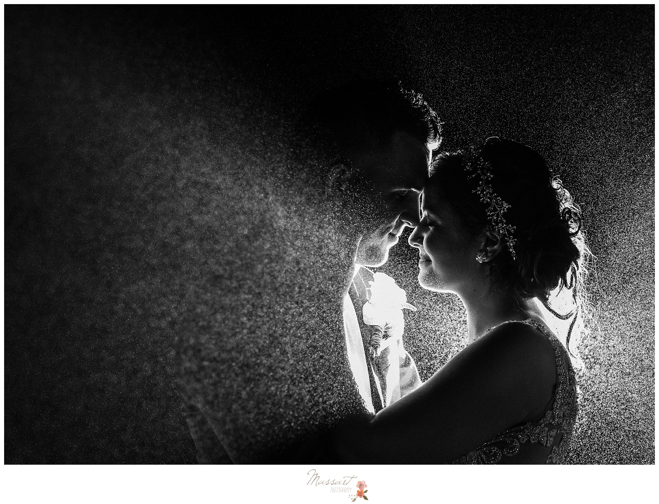Rainy wedding nighttime portrait photographed by RI wedding photographers Massart Photography.