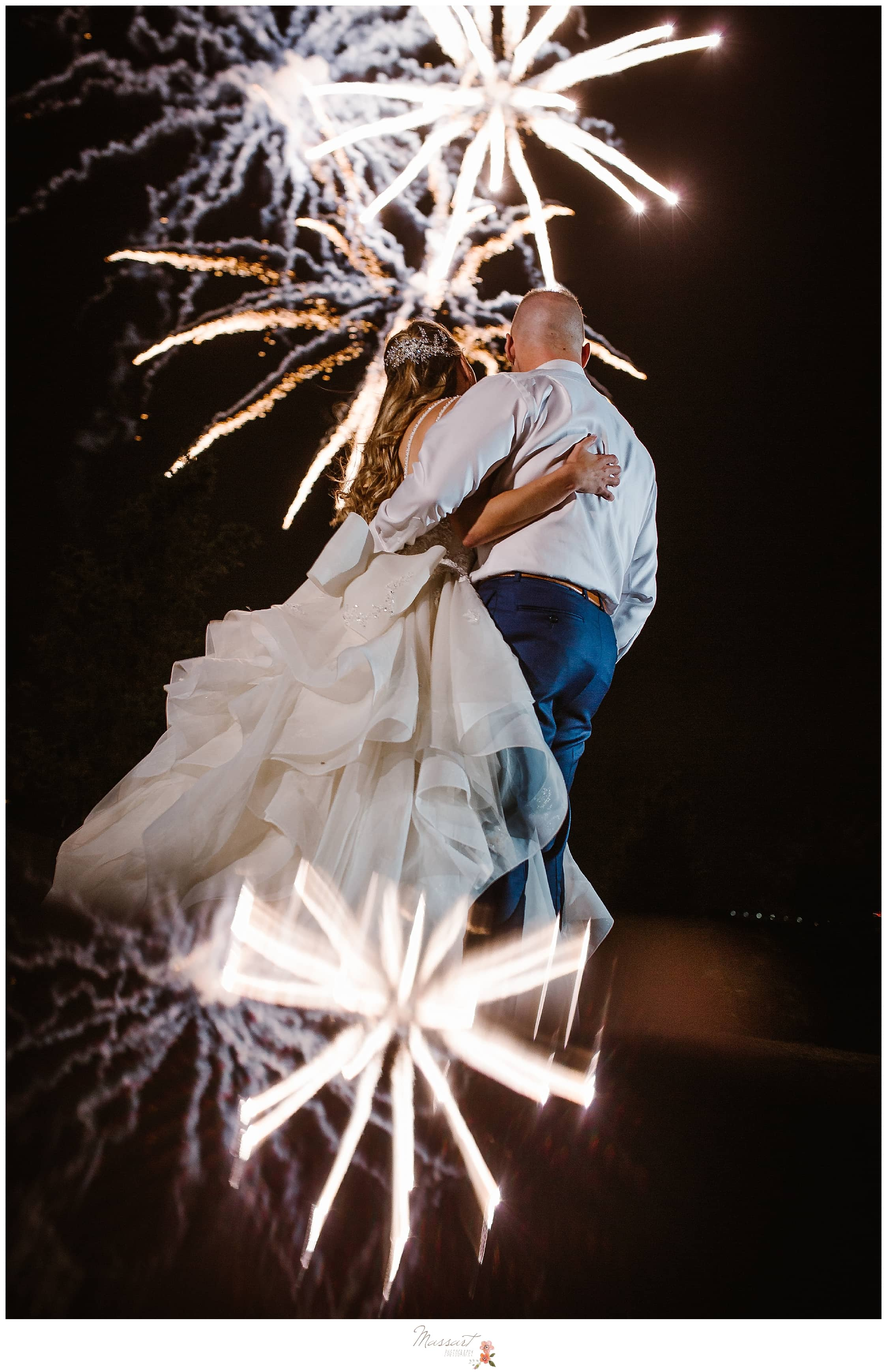 Massart Photography captured married couple with firework celebration at Castle Hill Inn Newport RI