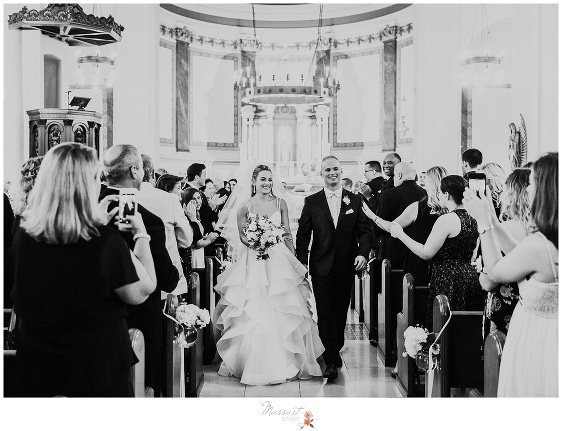 bride and groom recess up church aisle after Newport RI wedding ceremony photographed by Massart Photography