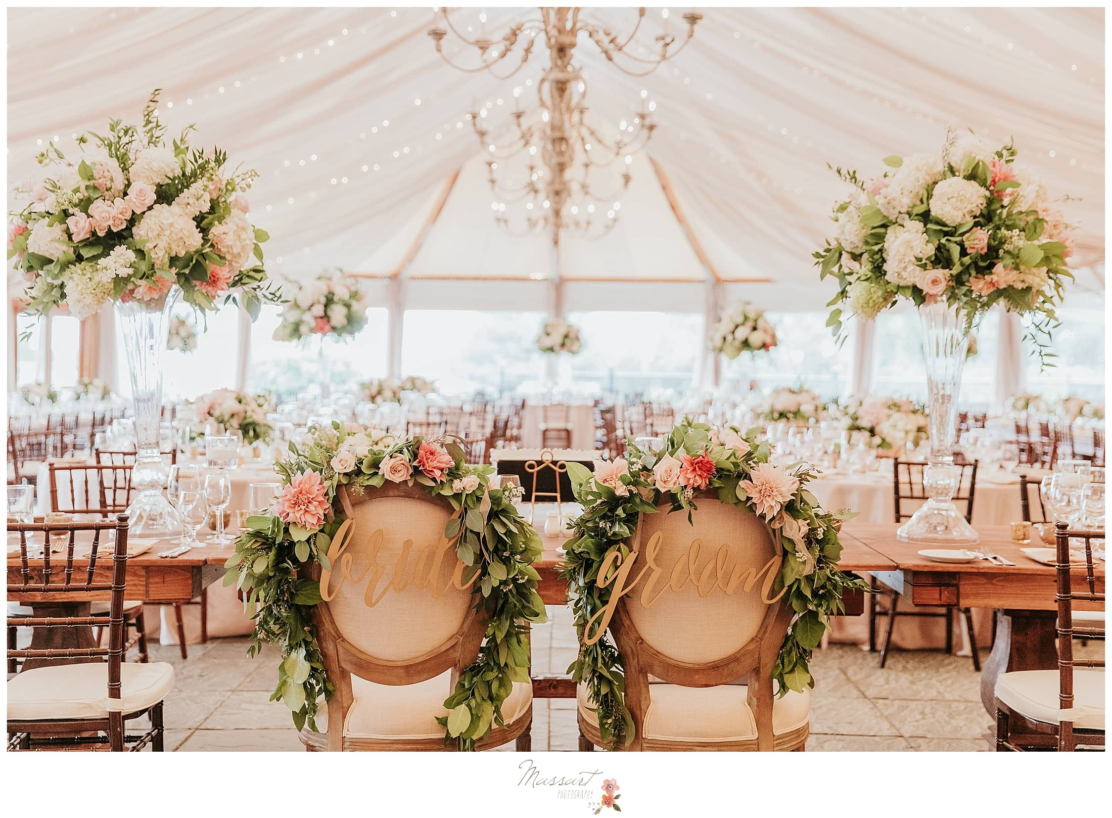 stunning tented reception with pink and green floral details by Sayles Livingston photographed by RI wedding photographers Massart Photography