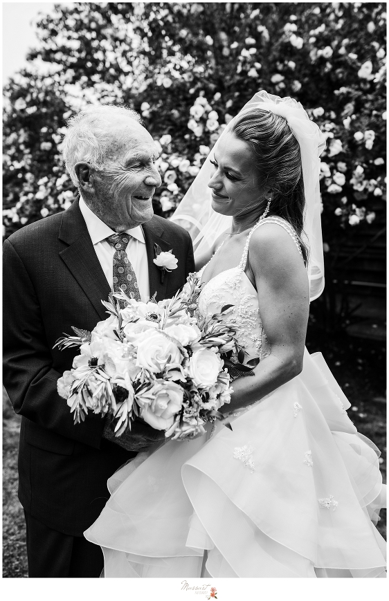 bride and grandfather pose during family formals by RI wedding photographers Massart Photography