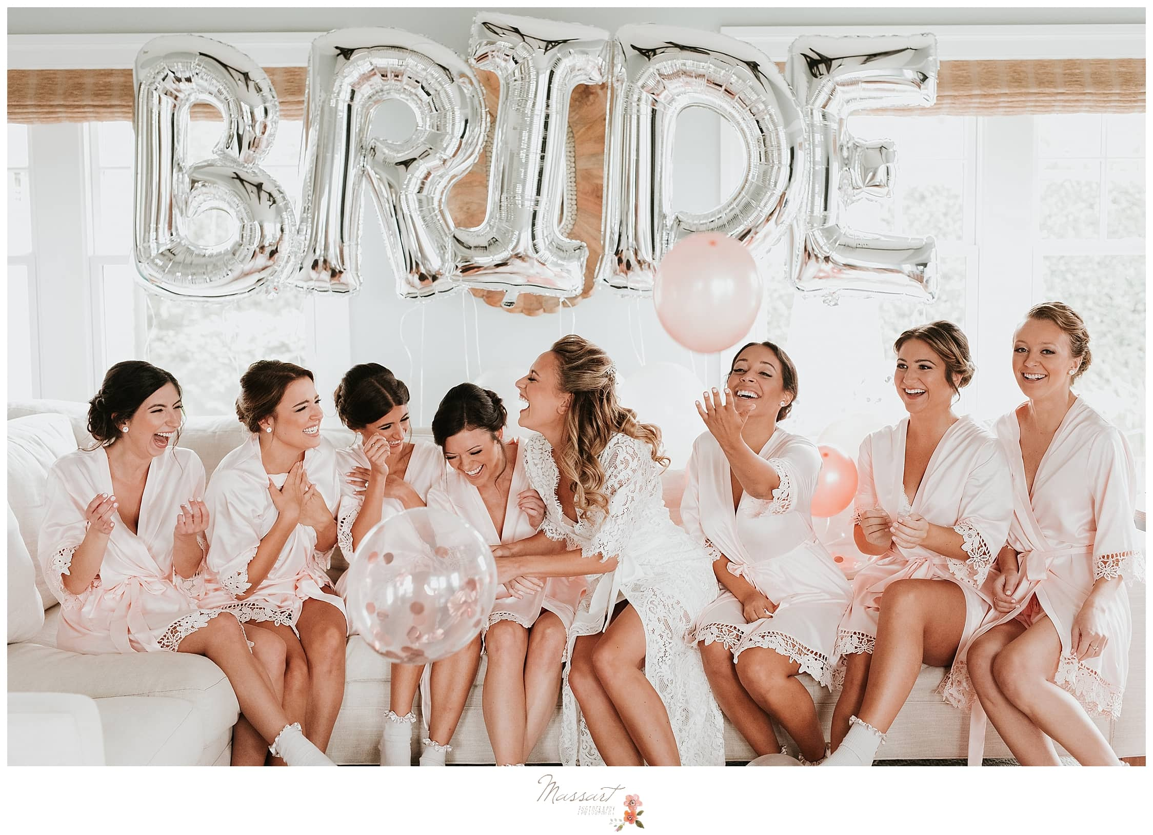 bride and bridesmaids with silver BRIDE balloons before wedding day at Castle Hill Inn photographed by Massart Photography