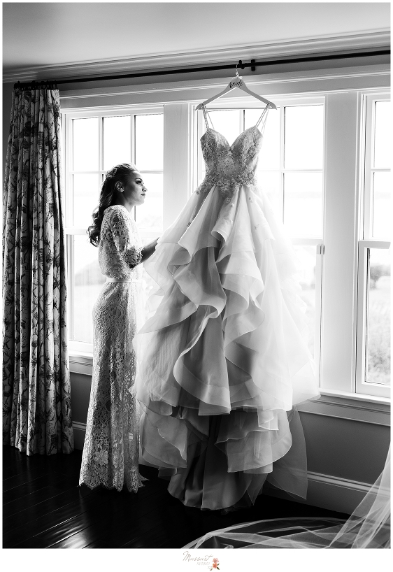 bride admiring wedding gown before wedding ceremony at Castle Hill Inn in Newport RI by Massart Photography