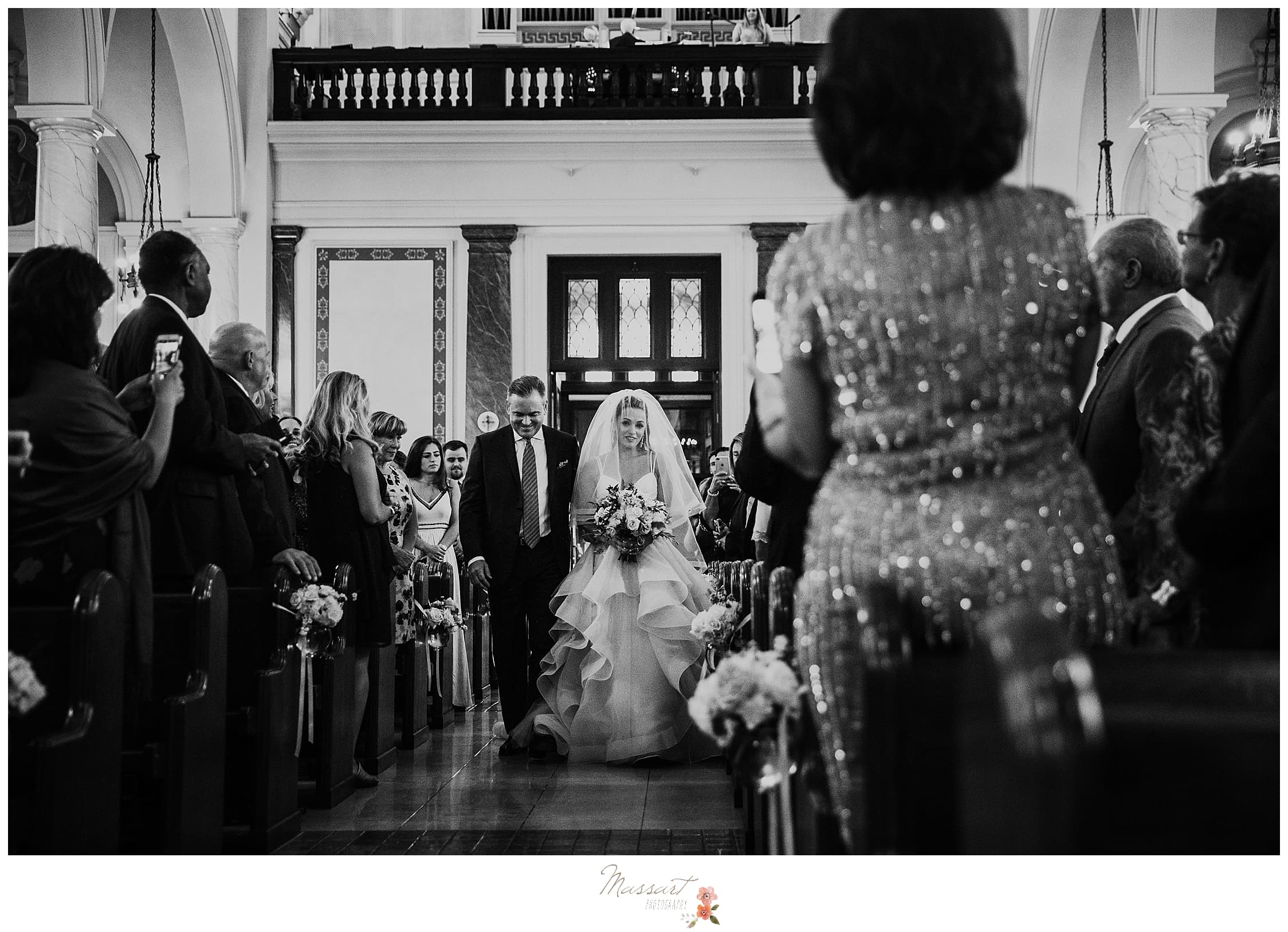 bride and father walk down aisle in church for wedding ceremony photographed by RI, MA, CT wedding photographers Massart Photography