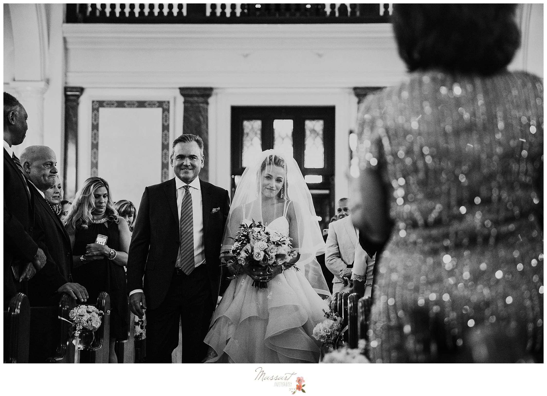 bride walks down the aisle in Newport RI photographed by Massart Photography