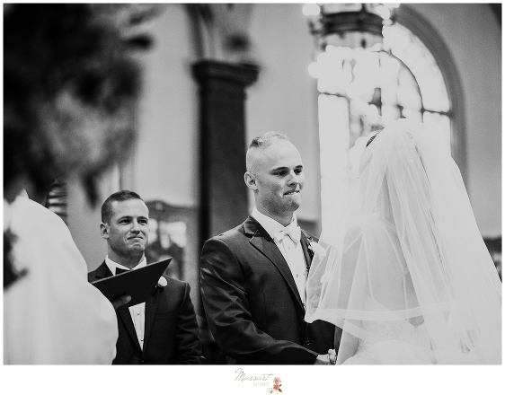 bride and groom exchange vows photographed by RI wedding photographers Massart Photography