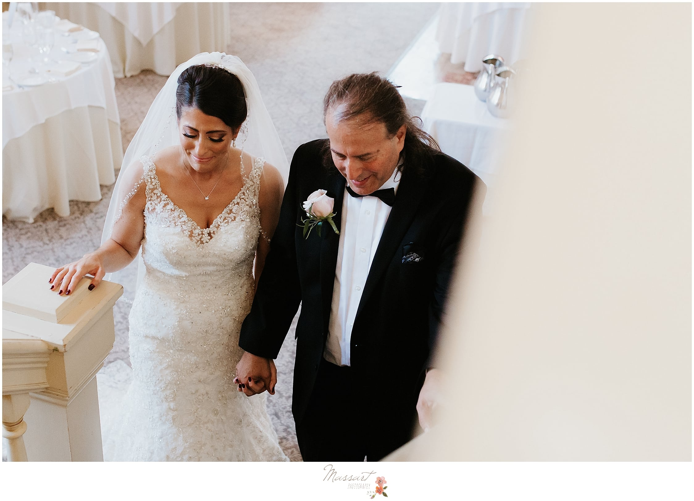 bride and father head into ceremony at The Dorrance in Providence photographed by Massart Photography