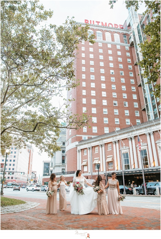bride and bridesmaids walk down street in Rhode Island photographed by massart Photography