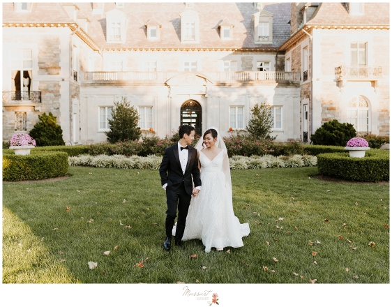 A portrait of the bride and groom in front of Aldrich mansion during their fall Rhode Island wedding captured by Massart Photographers
