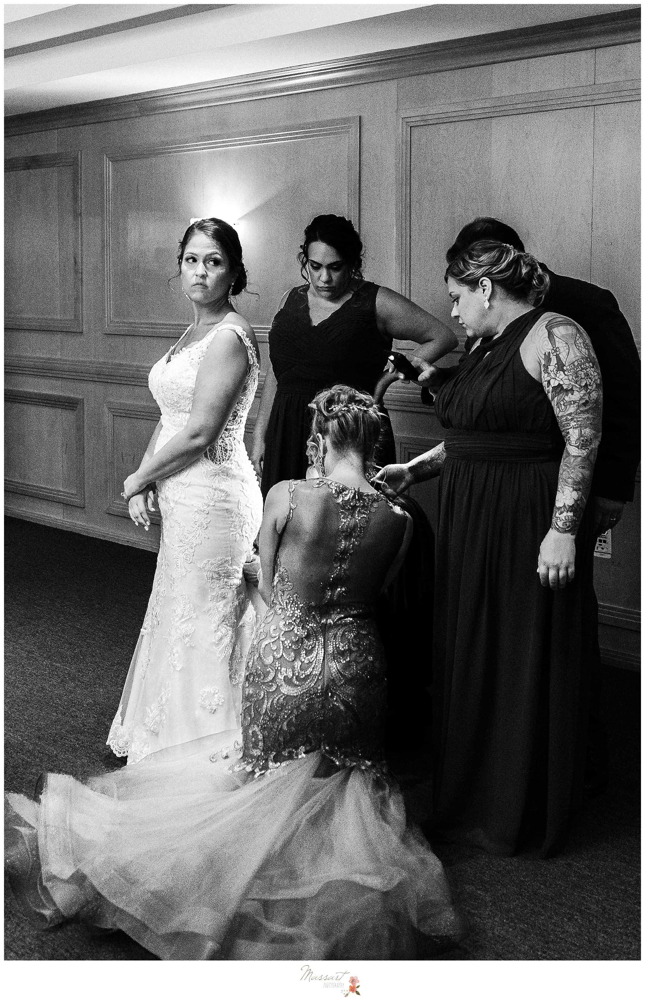 Bridesmaids bustle wedding gown for bride before Crowne Plaza in Warwick RI wedding reception