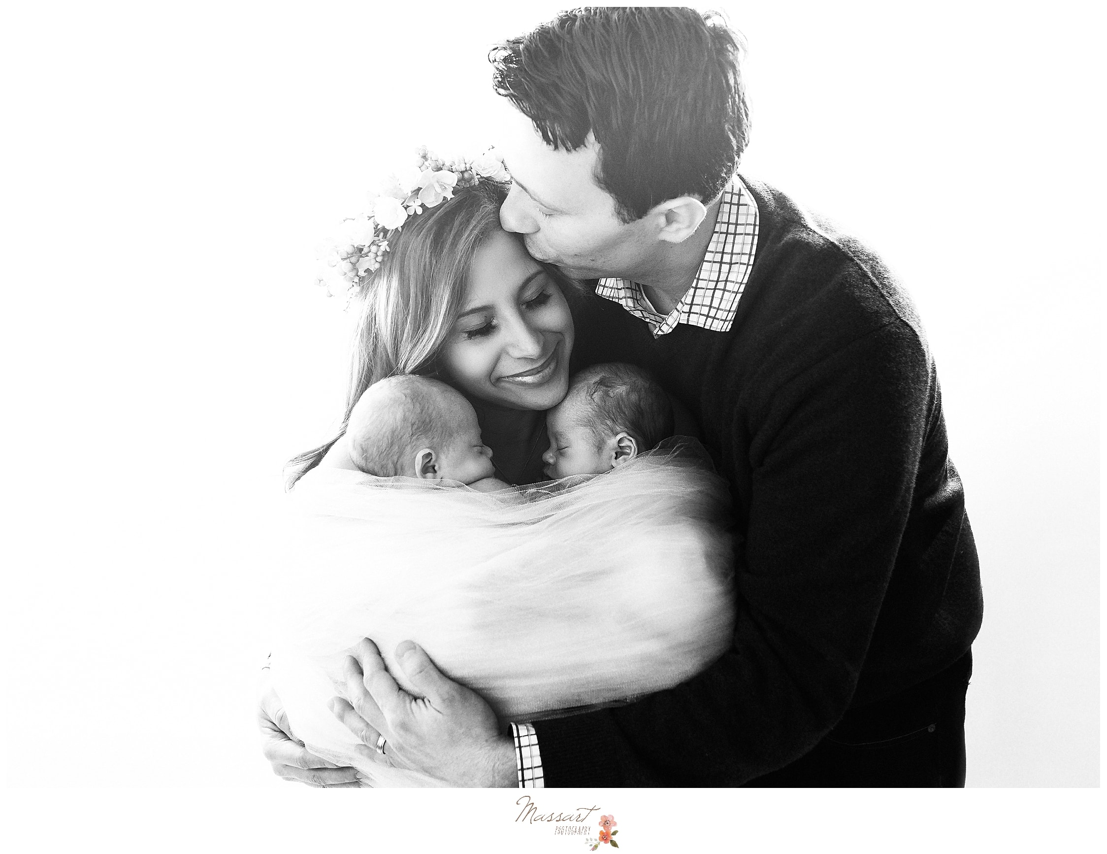A sweet moment of this family during their newborn photography session captured by Massart Photography