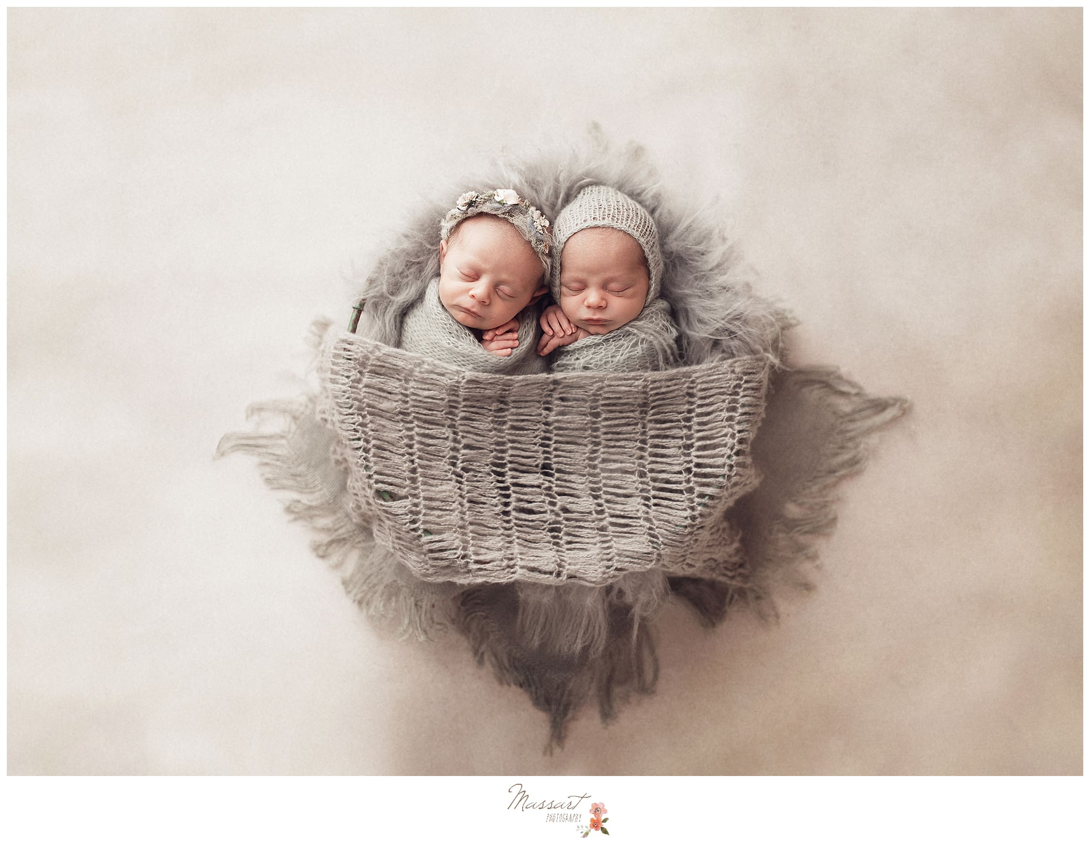 A fine art image of twins during a newborn photoshoot by Massart Photography in Rhode Island
