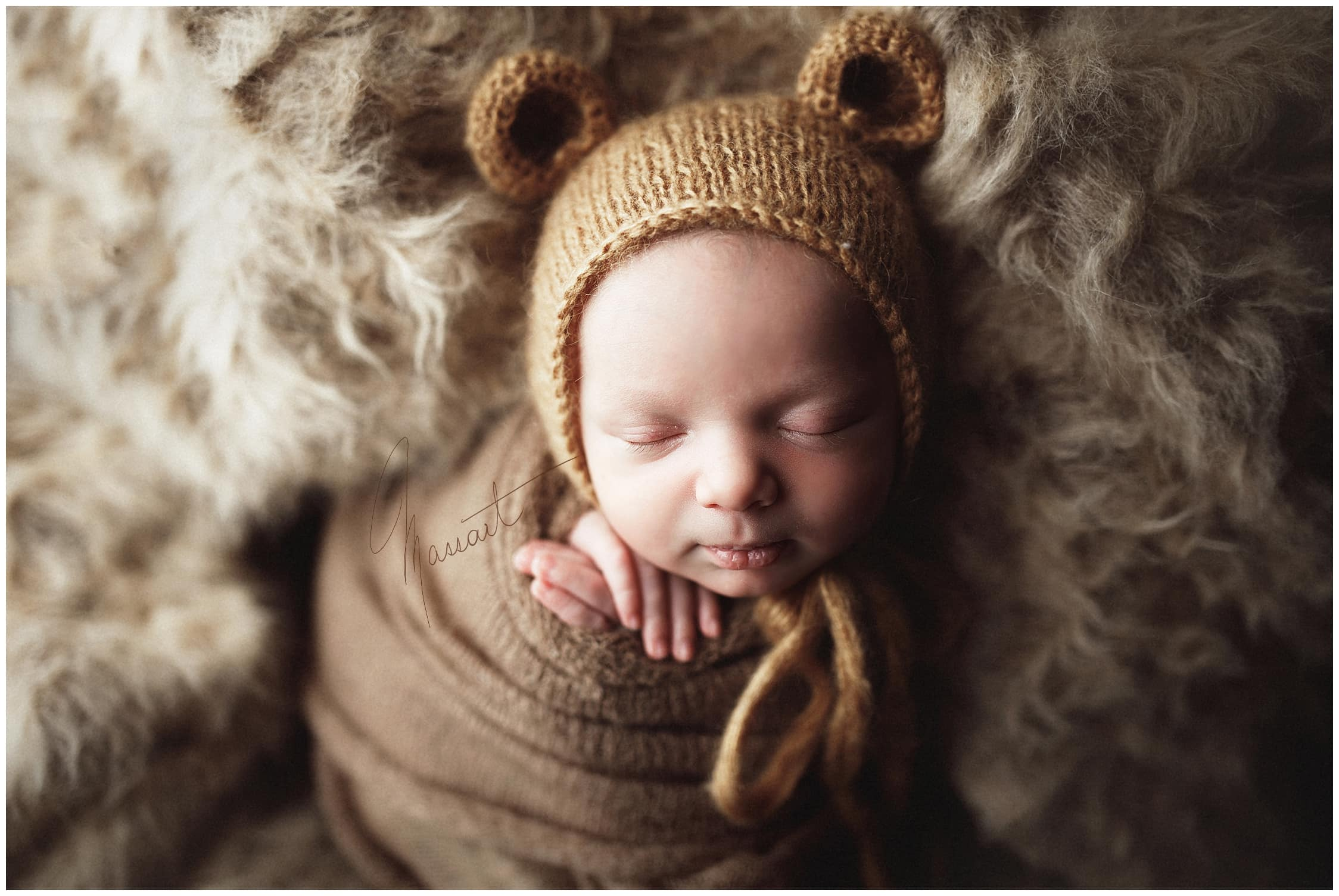 A sweet baby in a bear hat during his baby photo session in Rhode Island