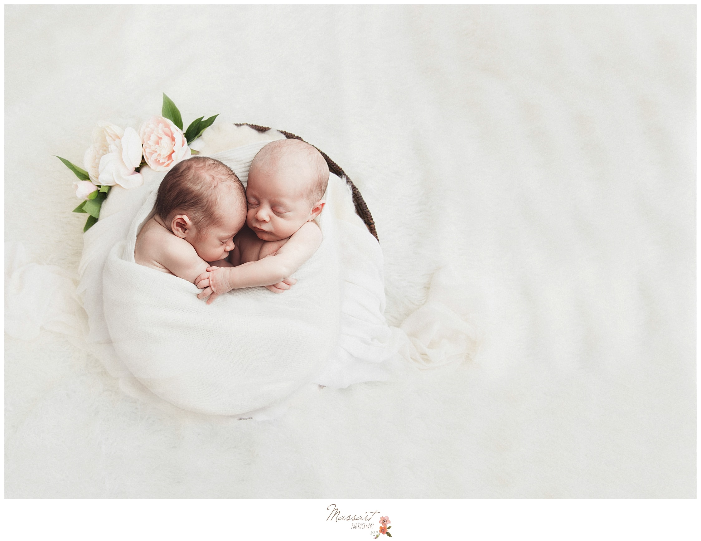 A timeless image of twins during their newborn session in RI