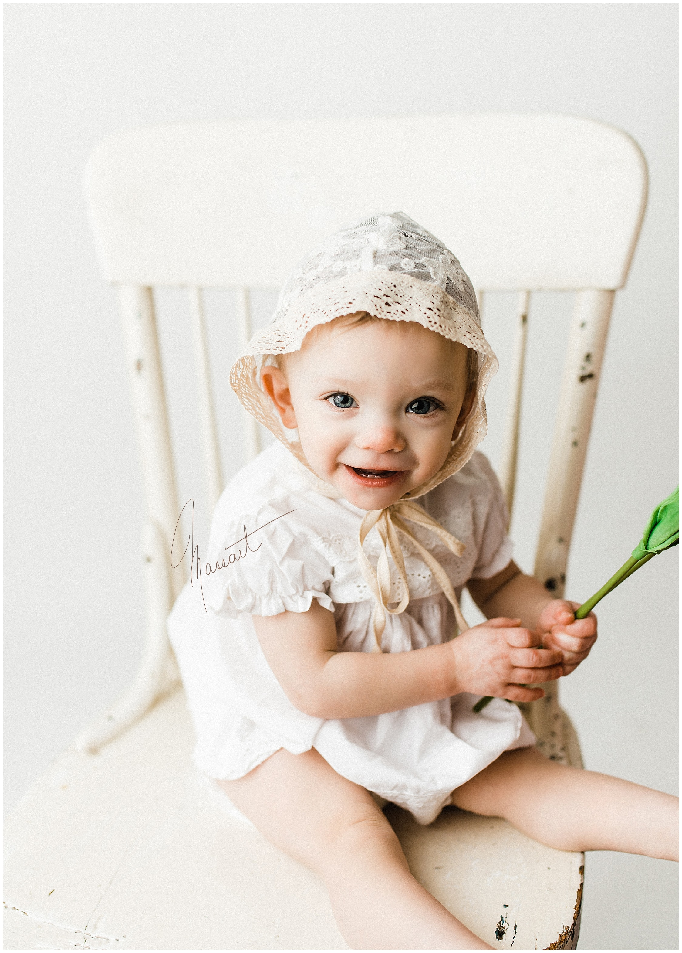 A timeless classic image of a baby girl during her photo shoot with Massart Photography in RI