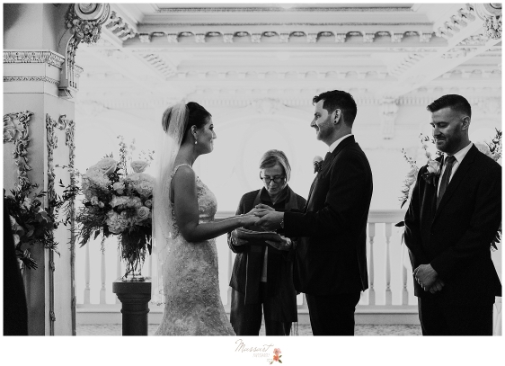 Massart photography captures a couple exchanging vows during their wedding ceremony at the dorrance in Providence, RI