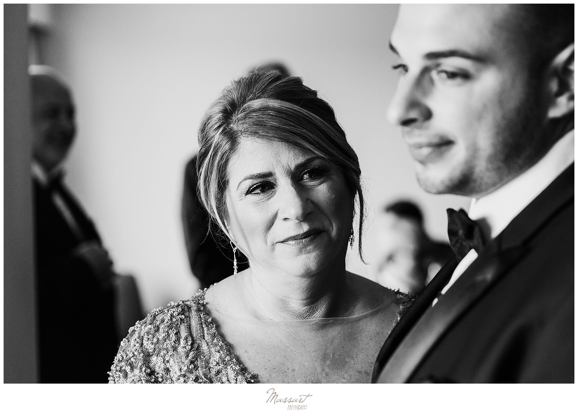 mother of groom watches preparations photographed by wedding photographers Massart Photography