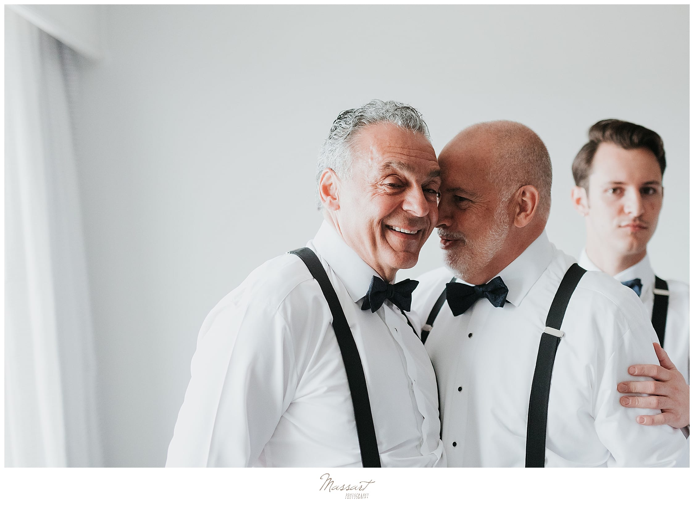 Fathers of the grooms prepare for Palace Theater wedding photographed by wedding photographers Massart Photography