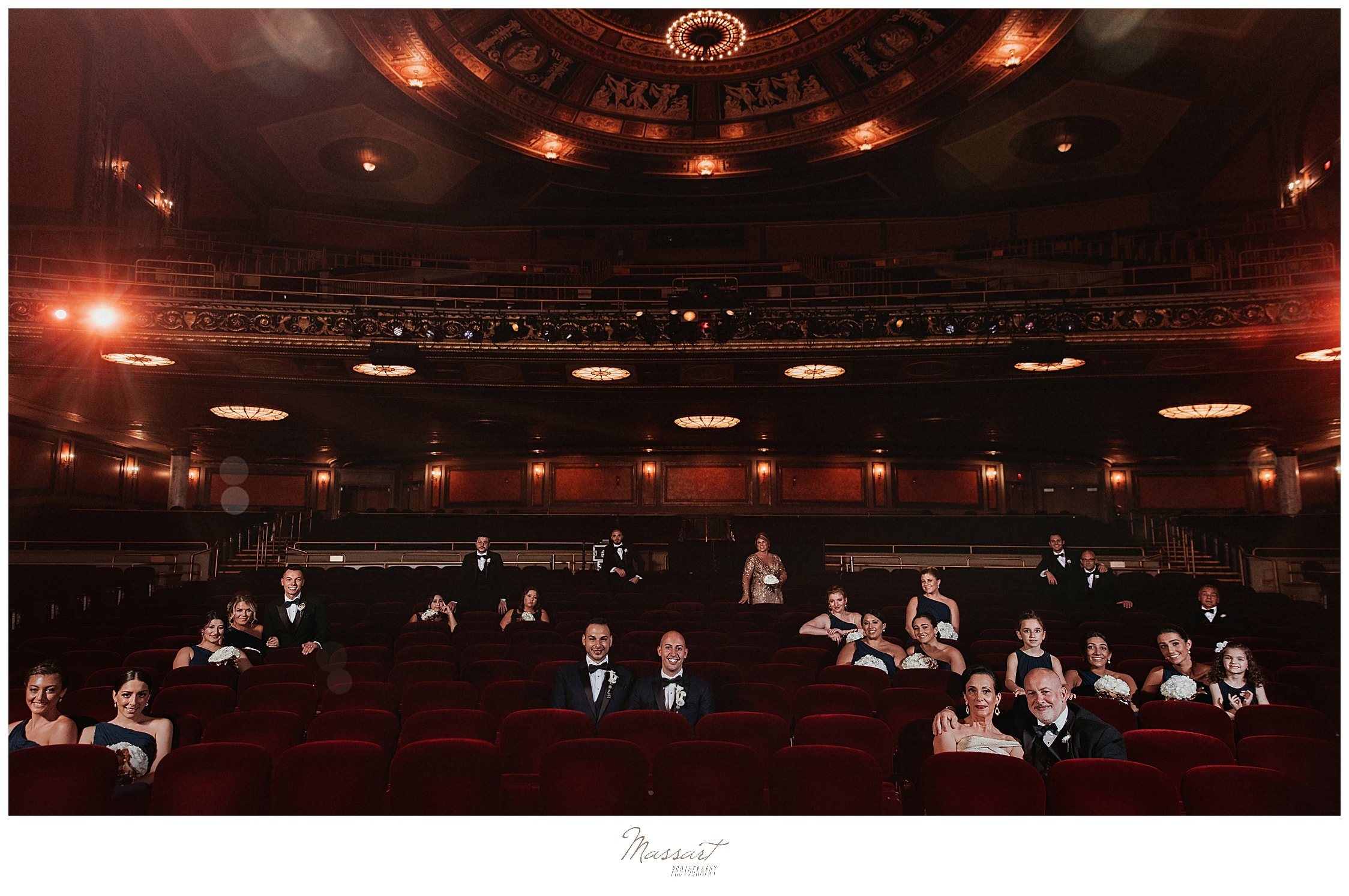 Dramatic wedding portraits in Palace Theater by wedding photographers Massart Photography