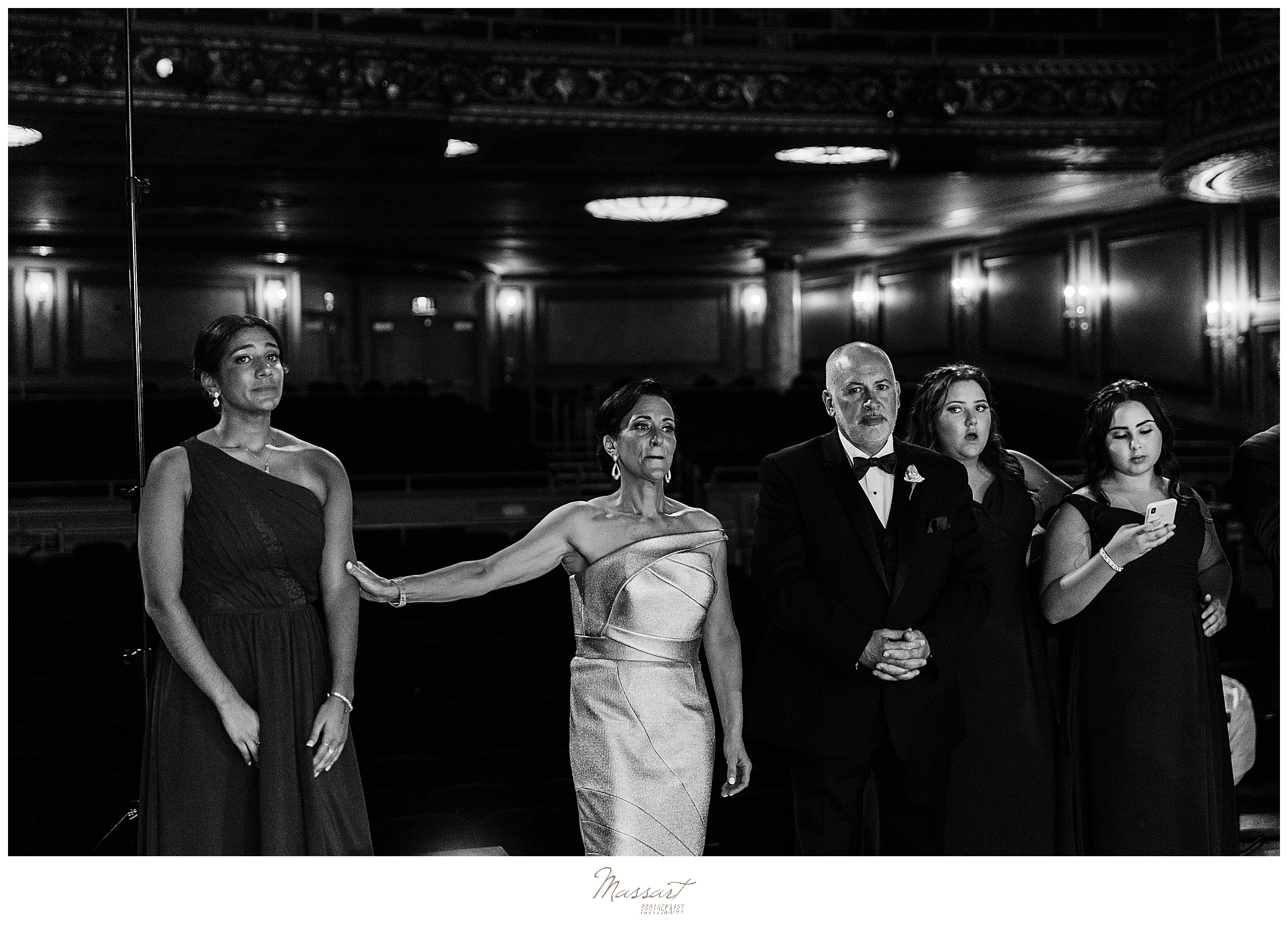 families watch first dance at Palace Theater with wedding photographers Massart Photography
