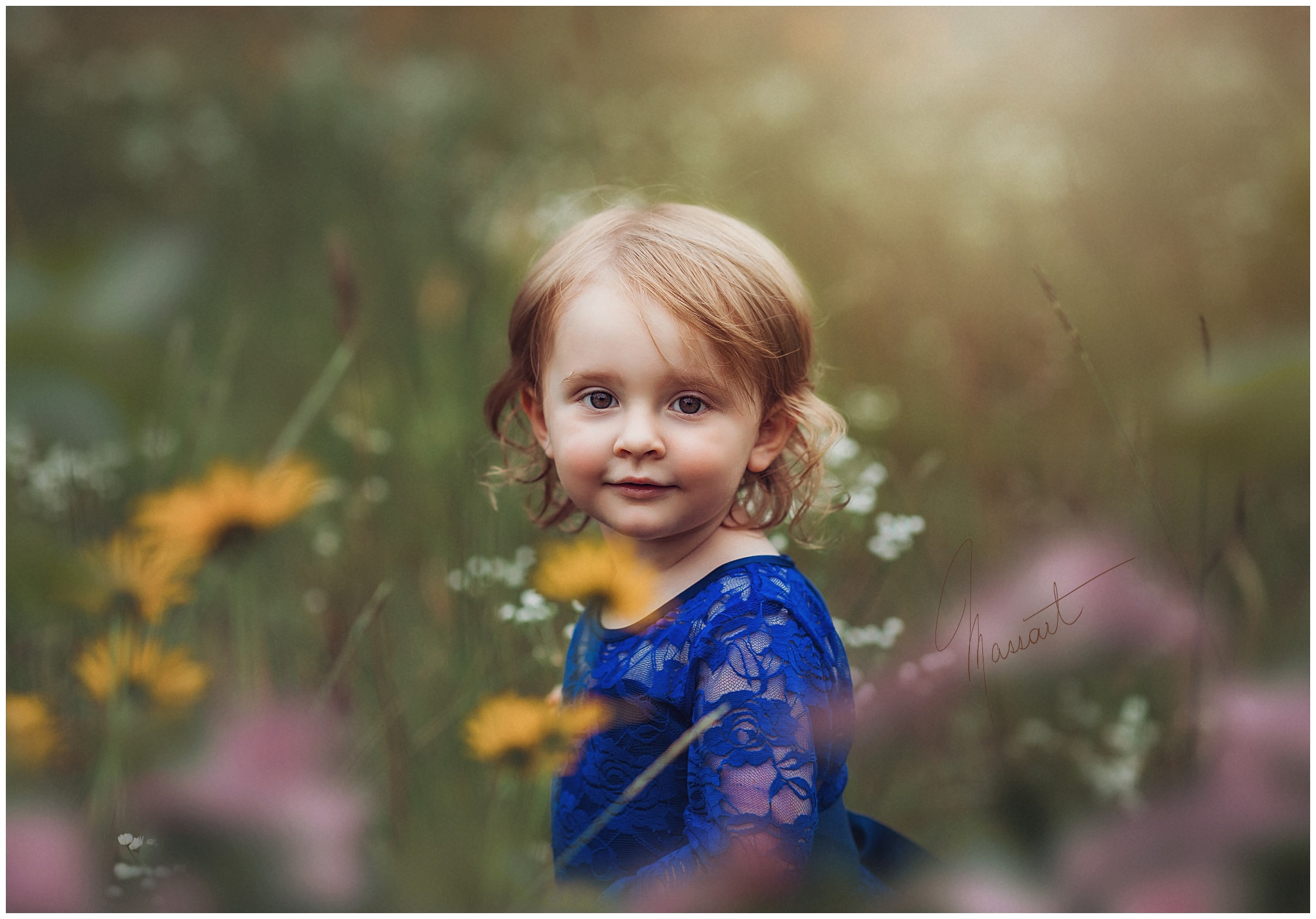 Portrait of a little girl during her family's photo session in RI with Massart Phtoographers