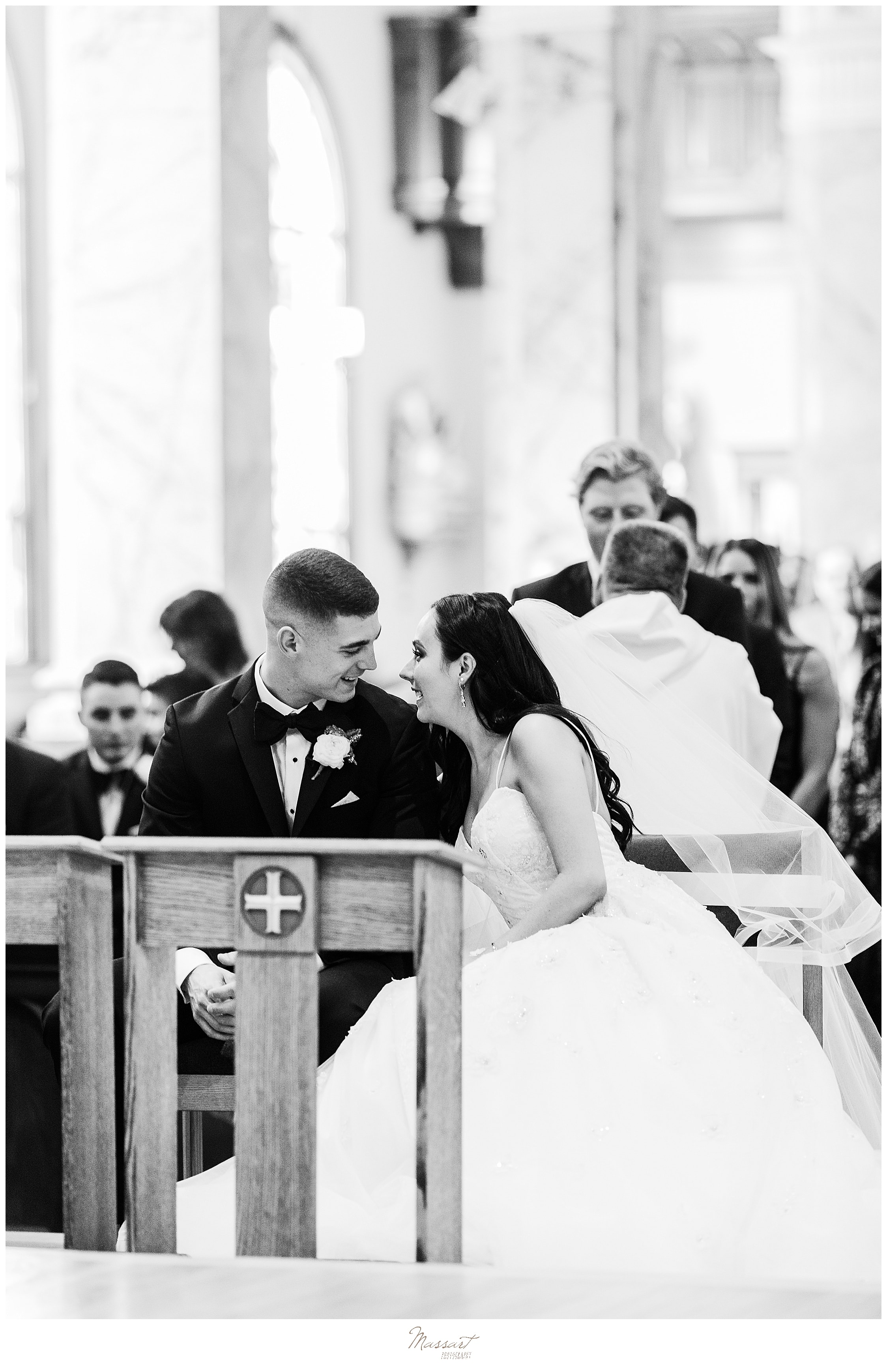 bride and groom laugh during wedding ceremony photographed by wedding photographers Massart Photography