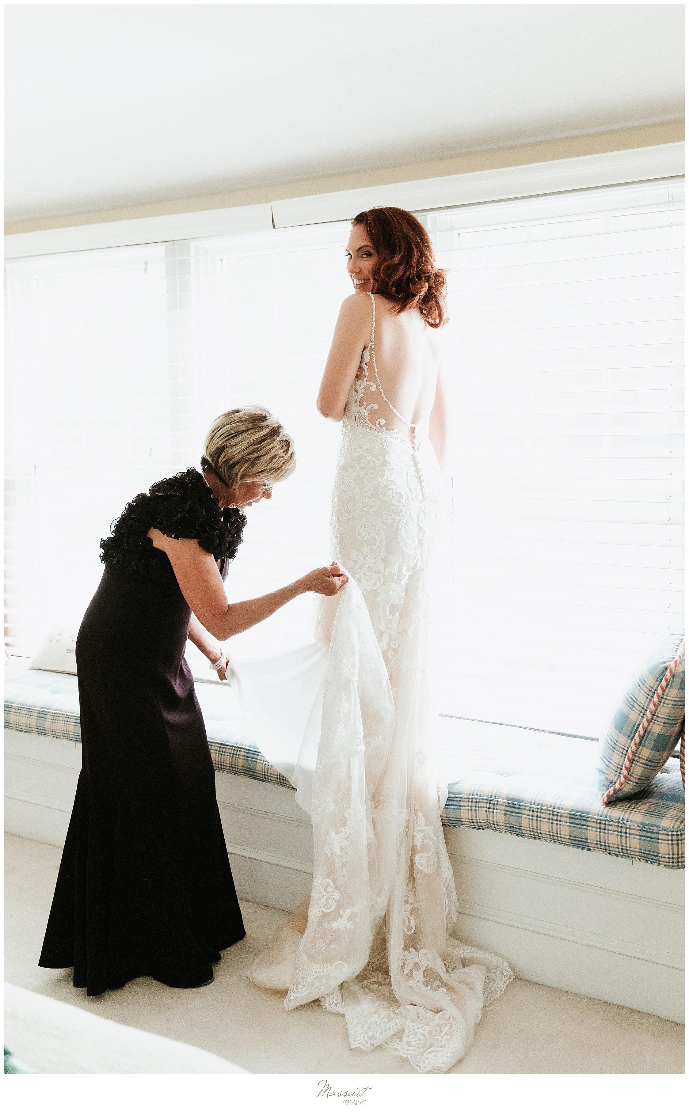bride getting wedding dress on in Rhode Island