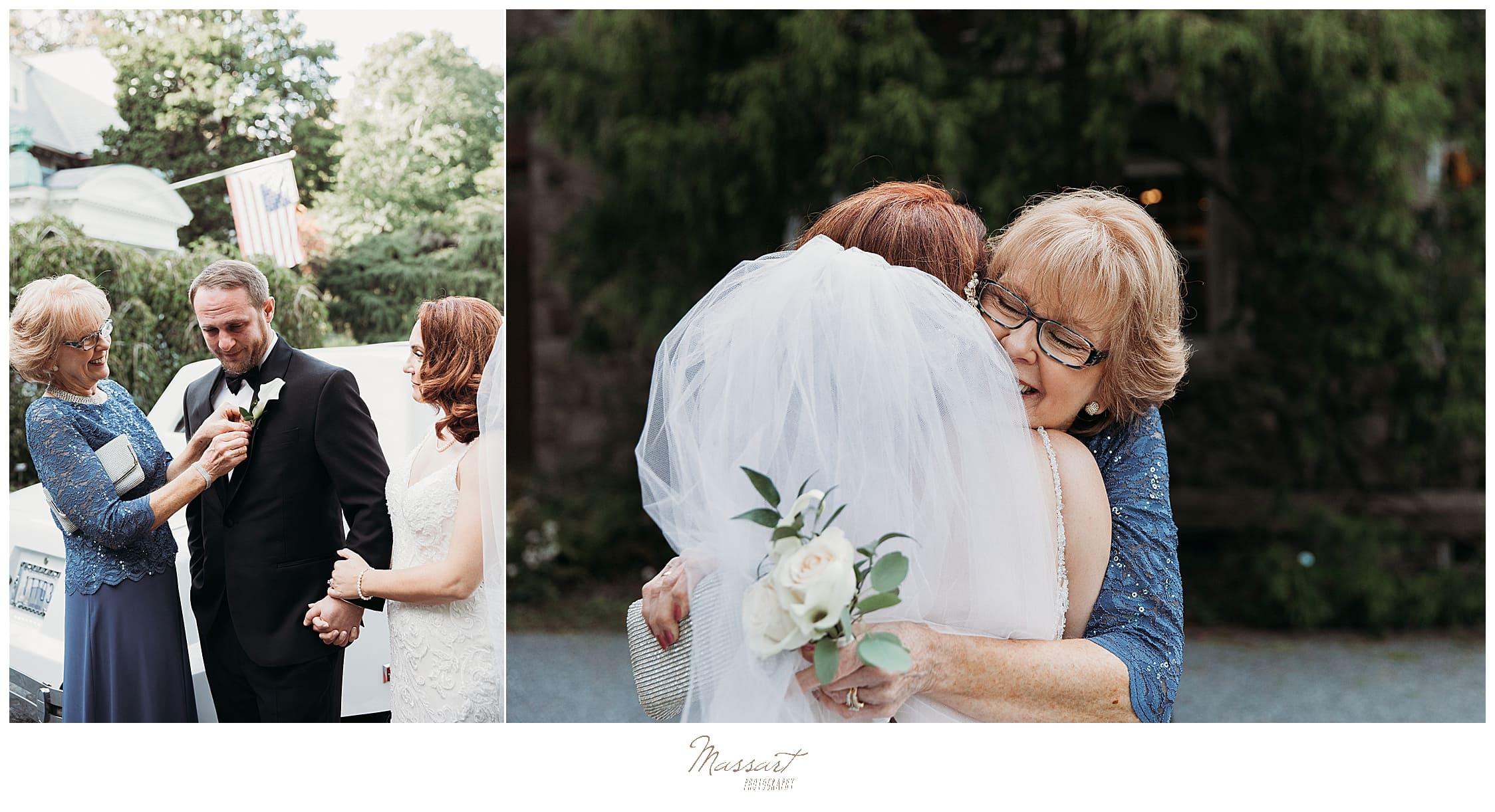 mother of groom hugging bride
