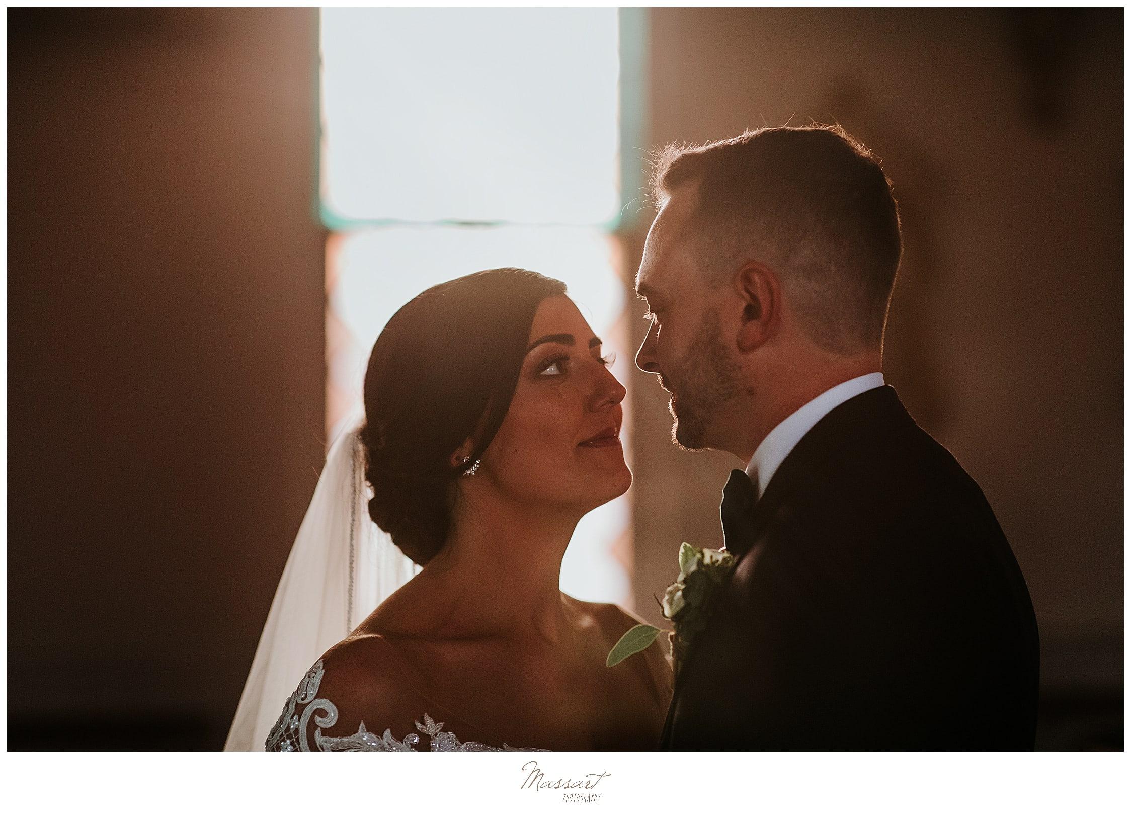 bride and groom pose for dramatic wedding portraits by Massachusetts wedding photographer Massart Photography