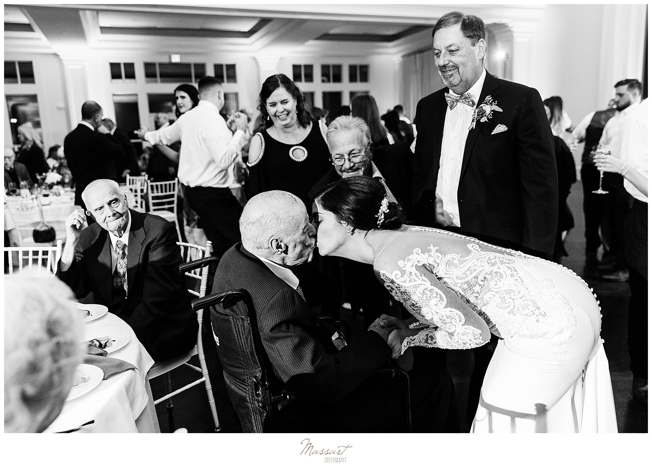 bride kisses grandfather on wedding day photographed by Massart Photography