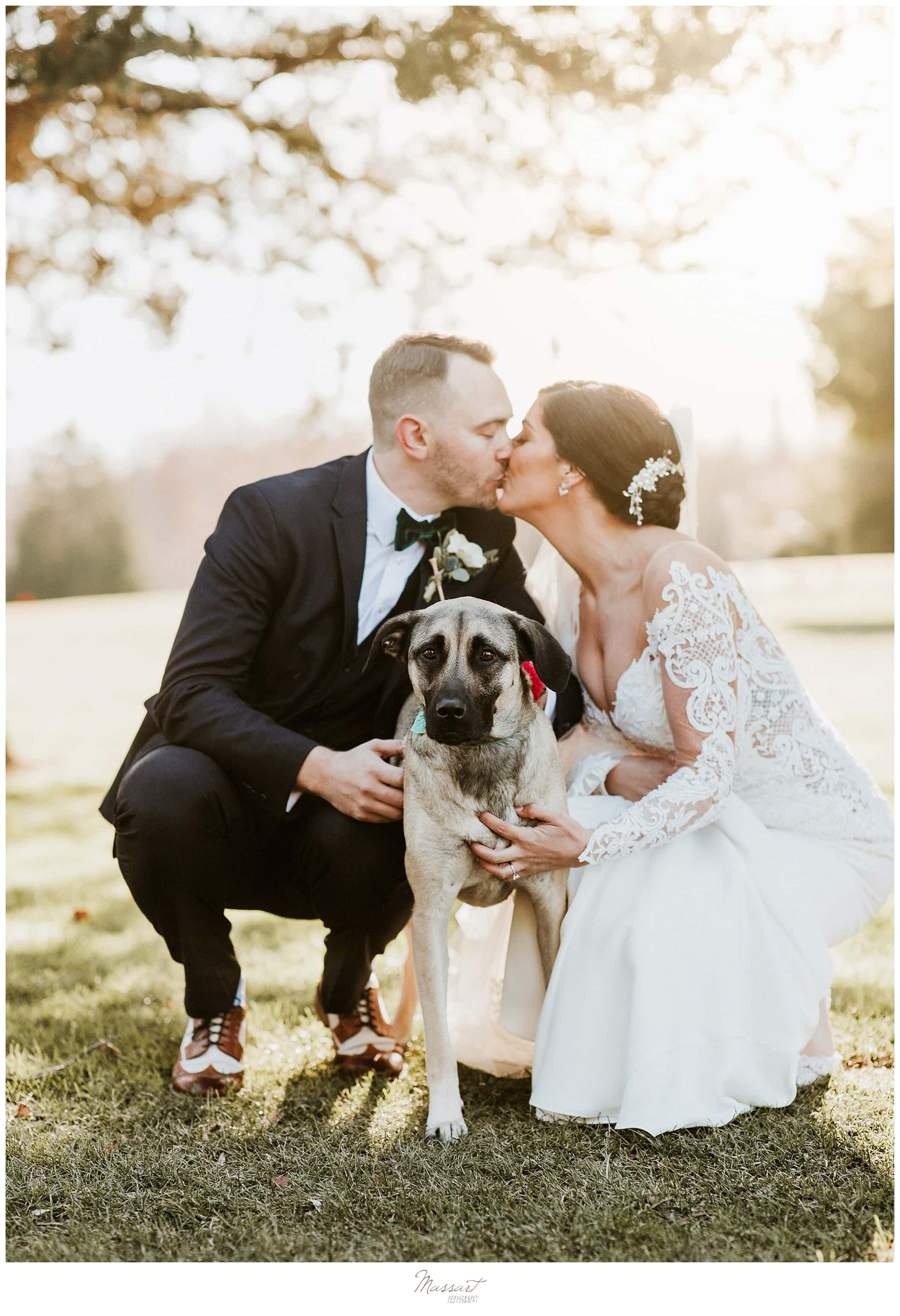 bride and groom pose with dog photographed by MA wedding photographer Massart Photography