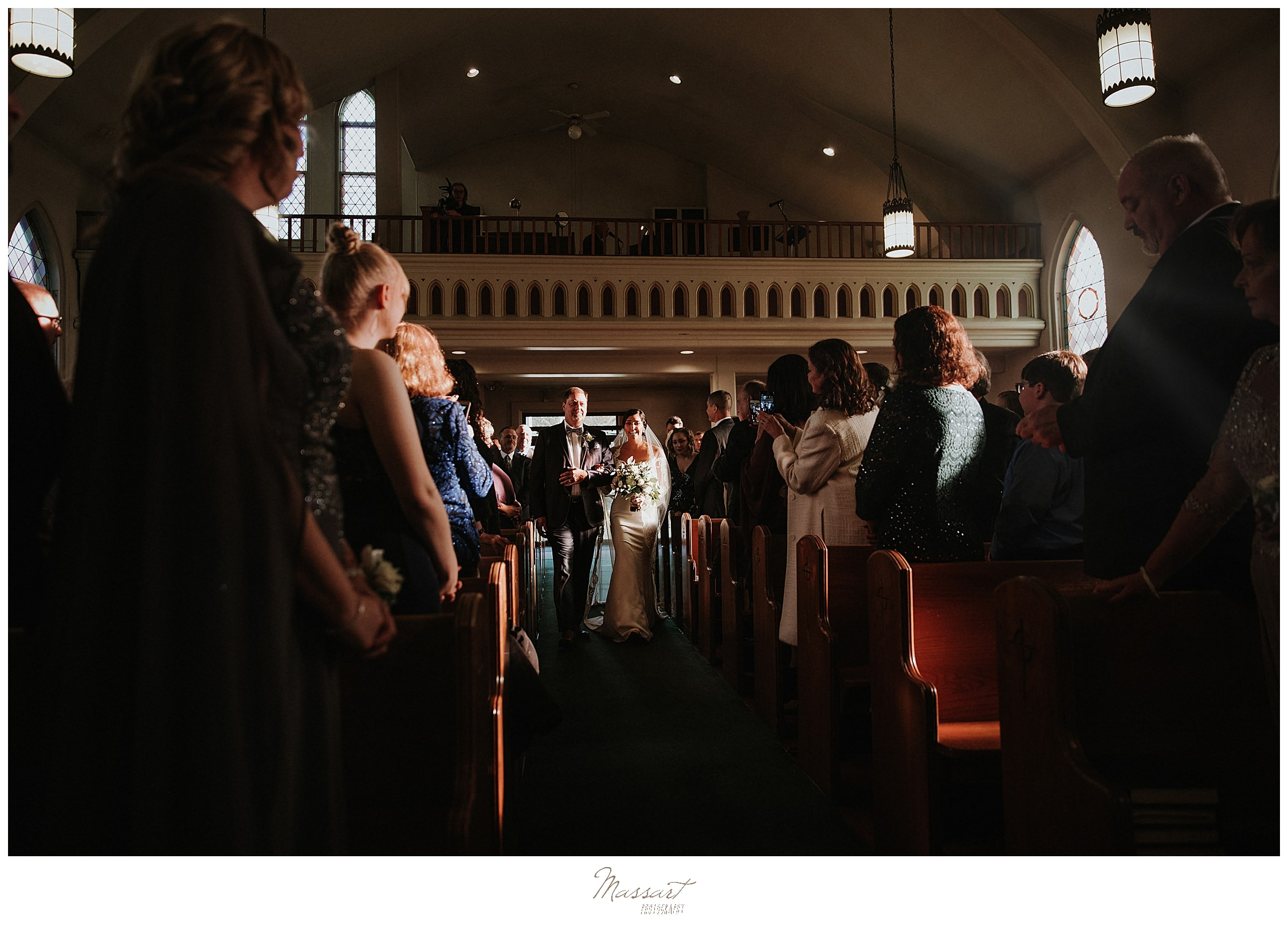 bride enters wedding ceremony with father photographed by Massart Photography
