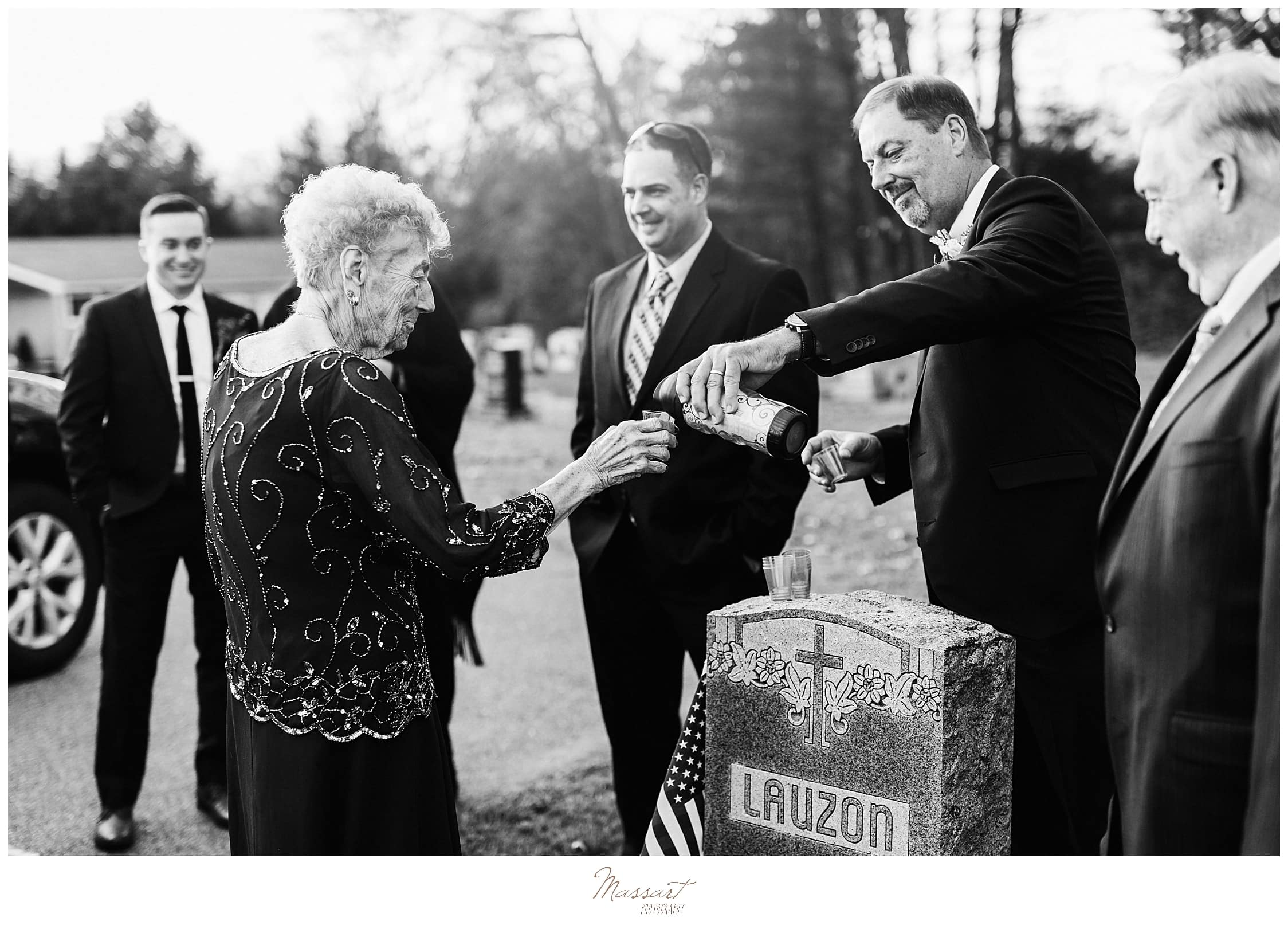 family toasts grandmother on wedding day with Massart Photography