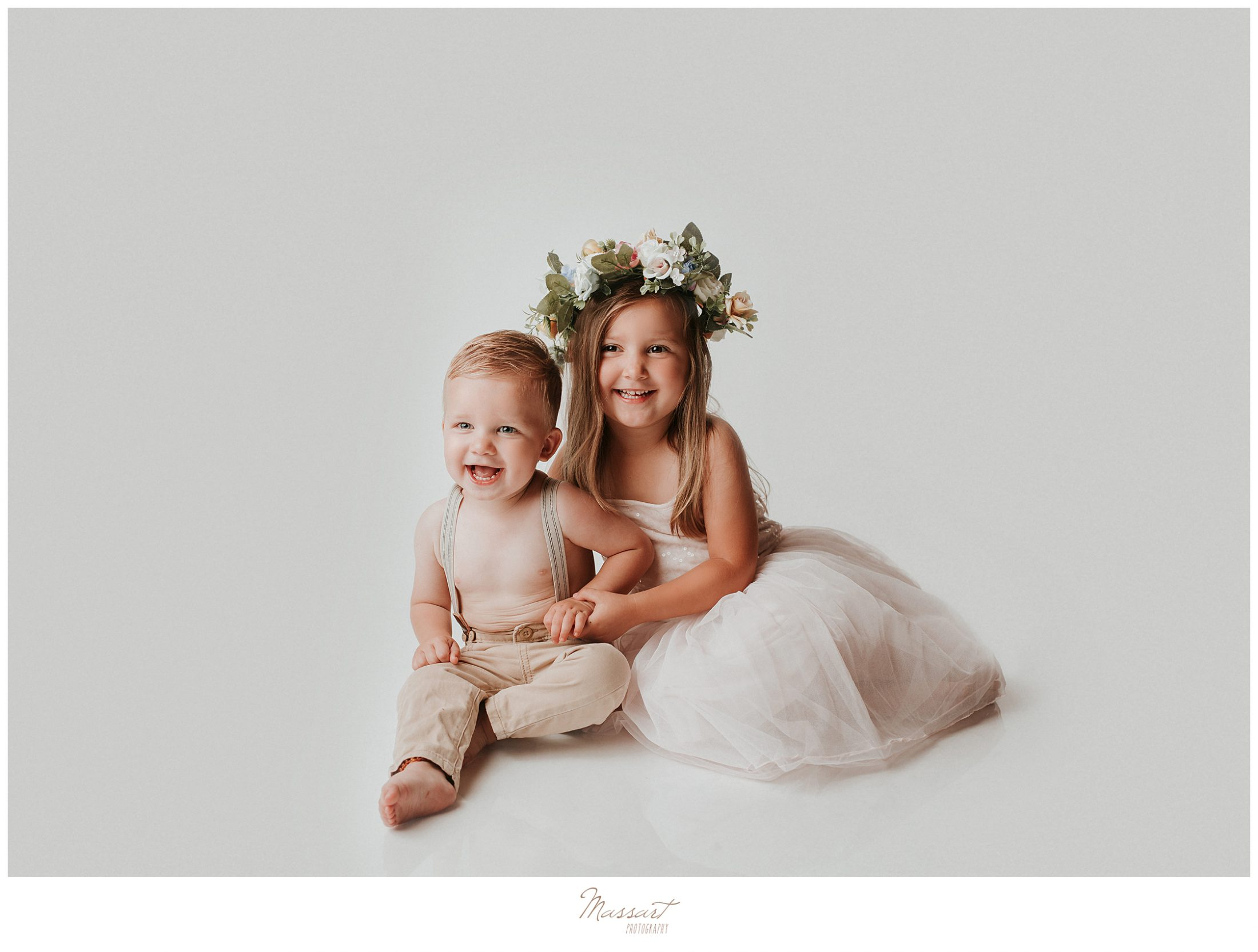 Siblings post for a portrait during their family session with Rhode Island and Connecticut photographers
