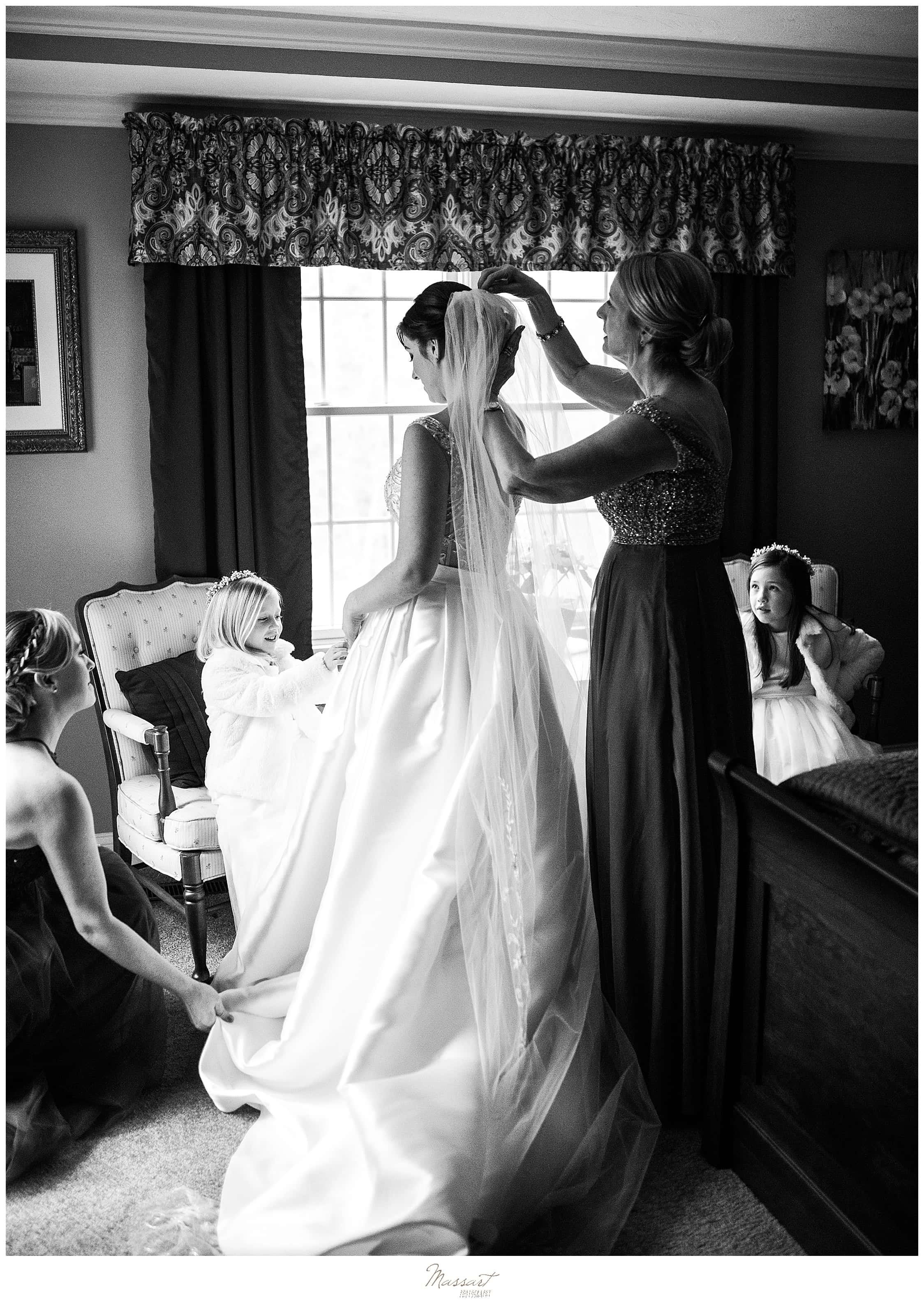 bride gets into wedding dress photographed by RI, MA, CT wedding photographers Massart Photography
