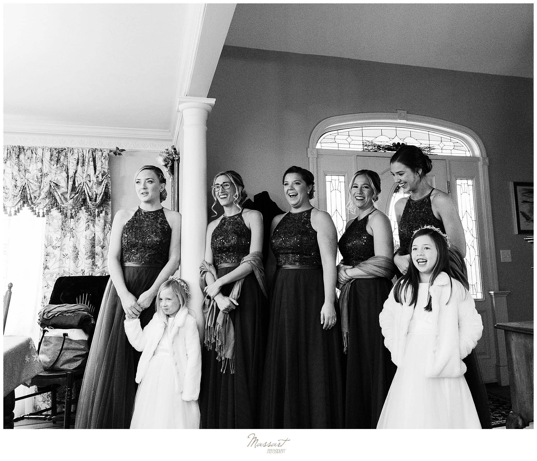 bridesmaids see bride in gown for the first time photographed by MA wedding photographers Massart Photography