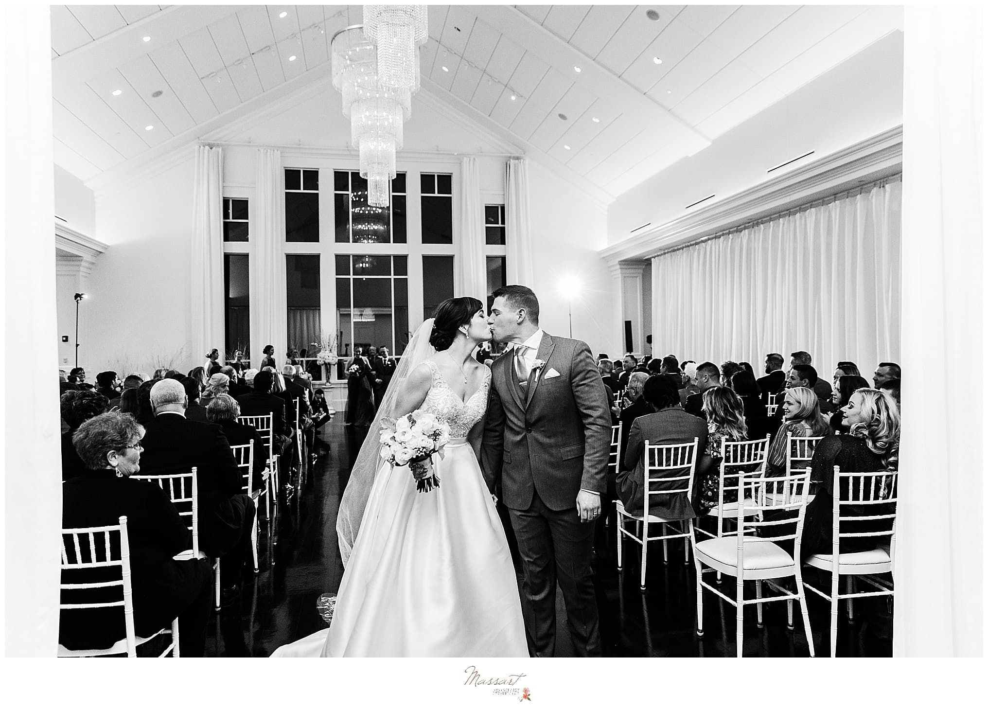 bride and groom kissing after wedding ceremony at Lakeview Pavilion shot by Massart Photography Photography
