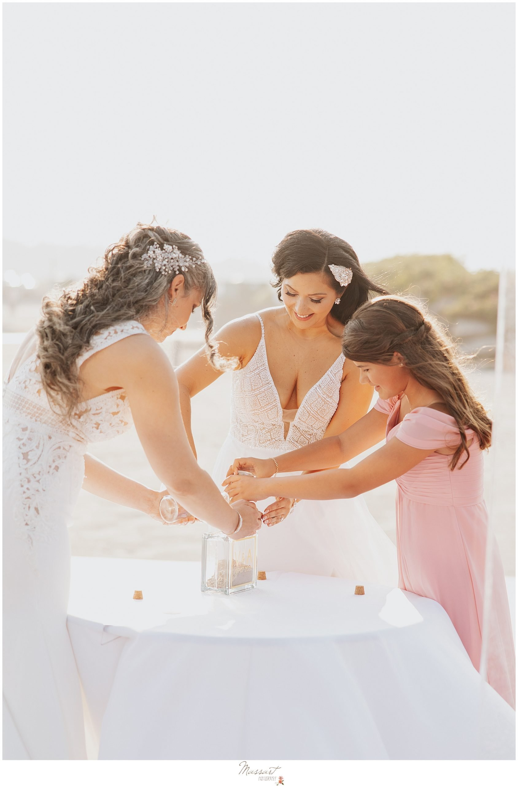 brides do sand ceremony with daughter in Rhode Island