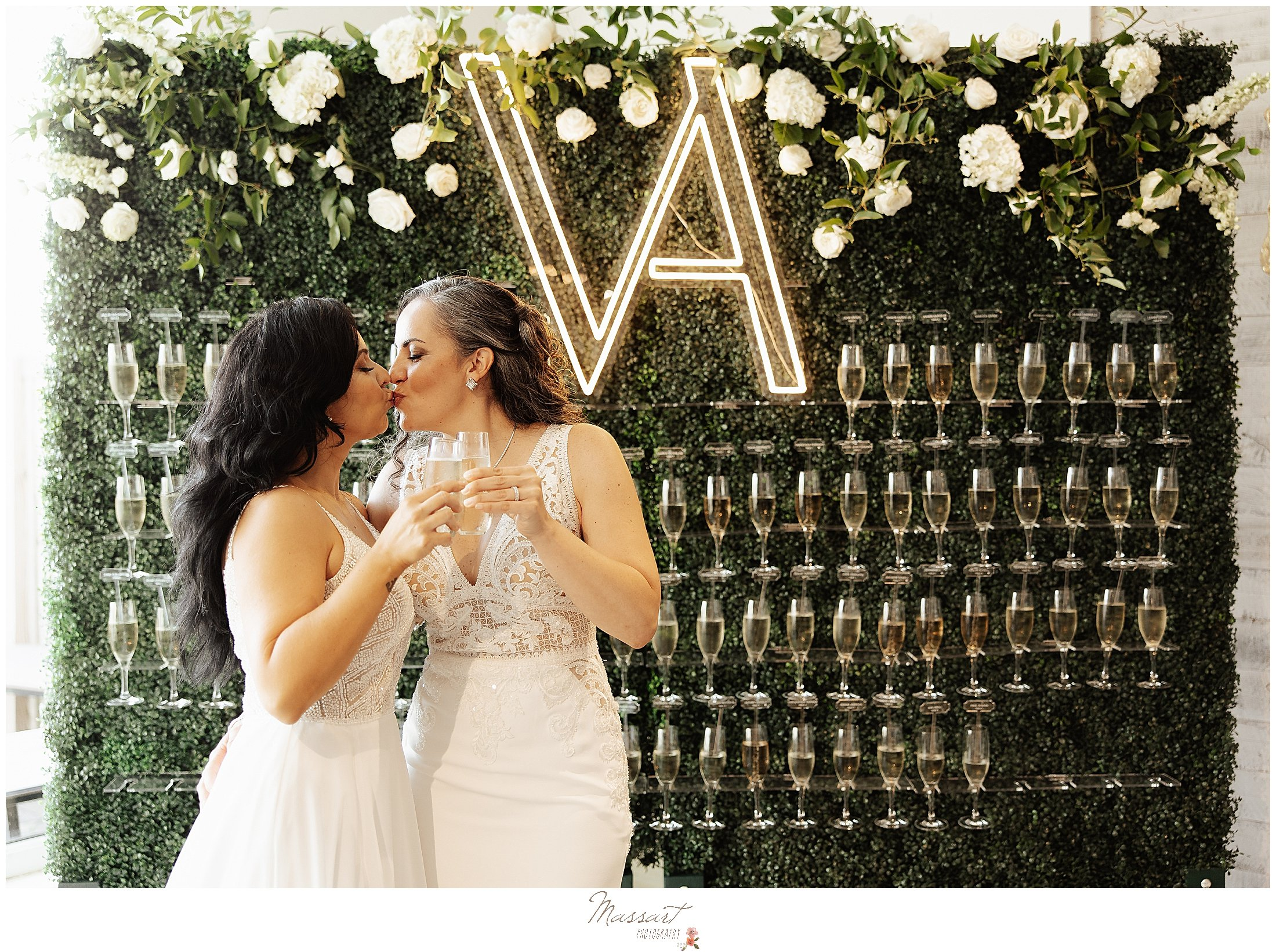brides toasts champagne during wedding reception