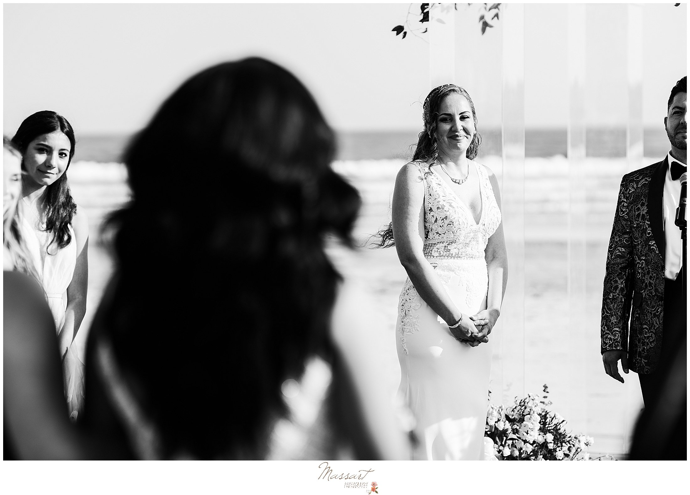 bride watches bride walk down aisle during Newport Beach House ceremony