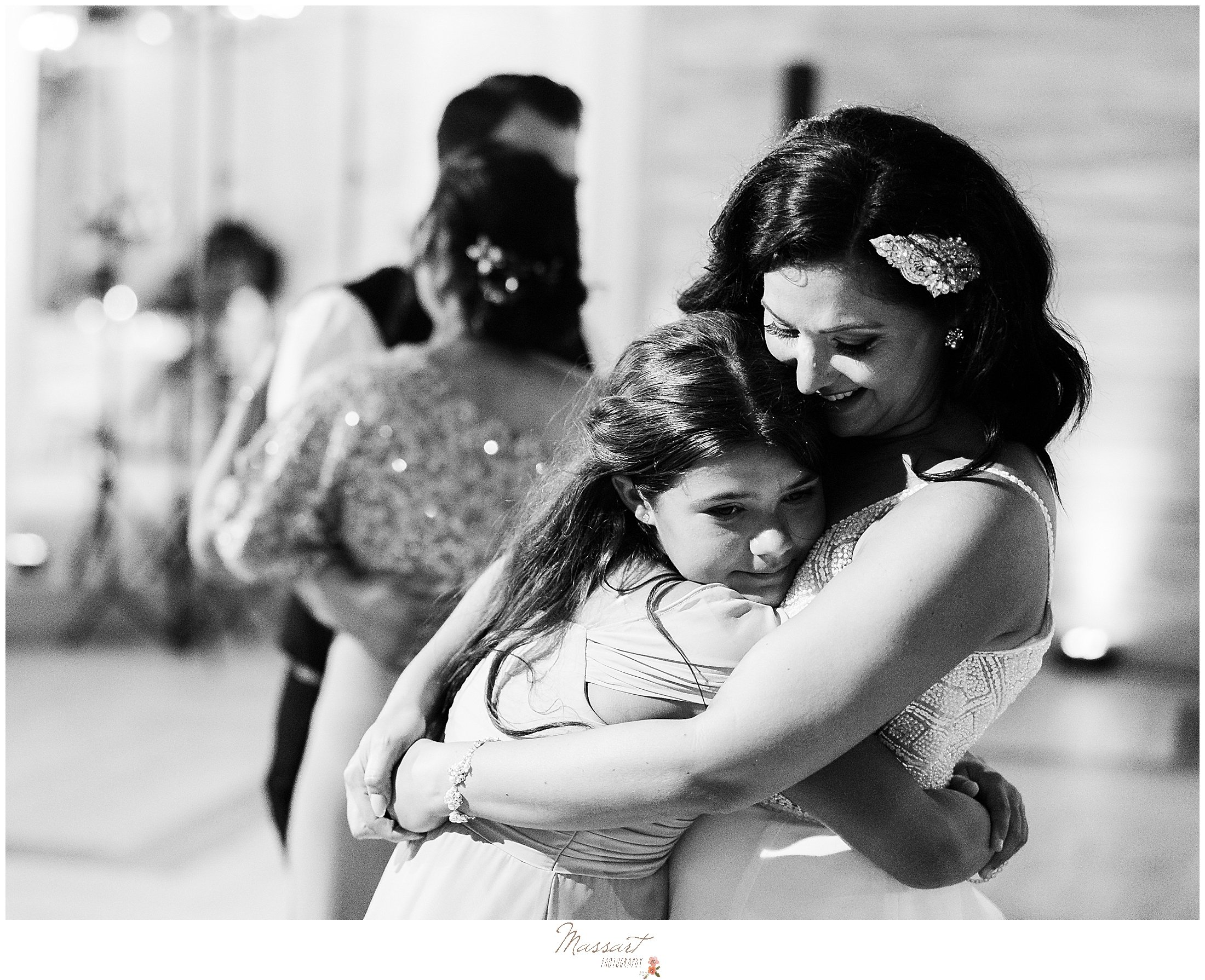 bride hugs daughter during mother-daughter dance at Newport Beach House