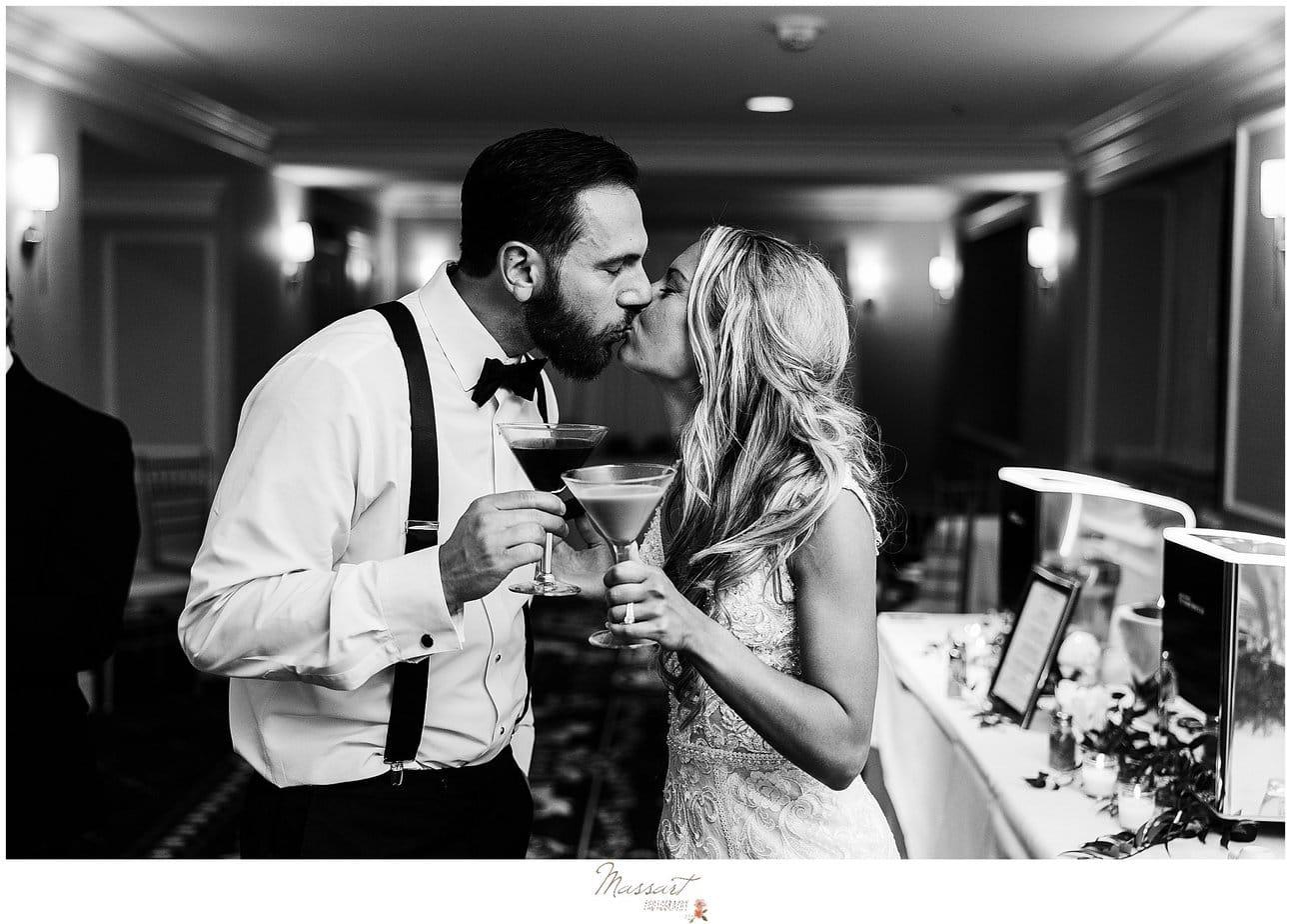 newlyweds toast martinis at bar during Graduate Hotel wedding reception