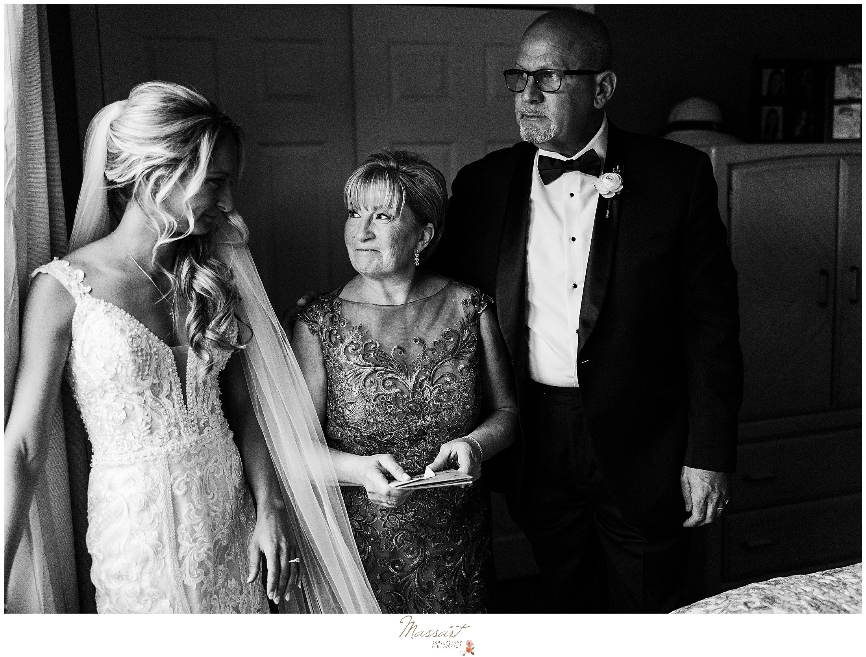 parents look at bride before Graduate Hotel wedding