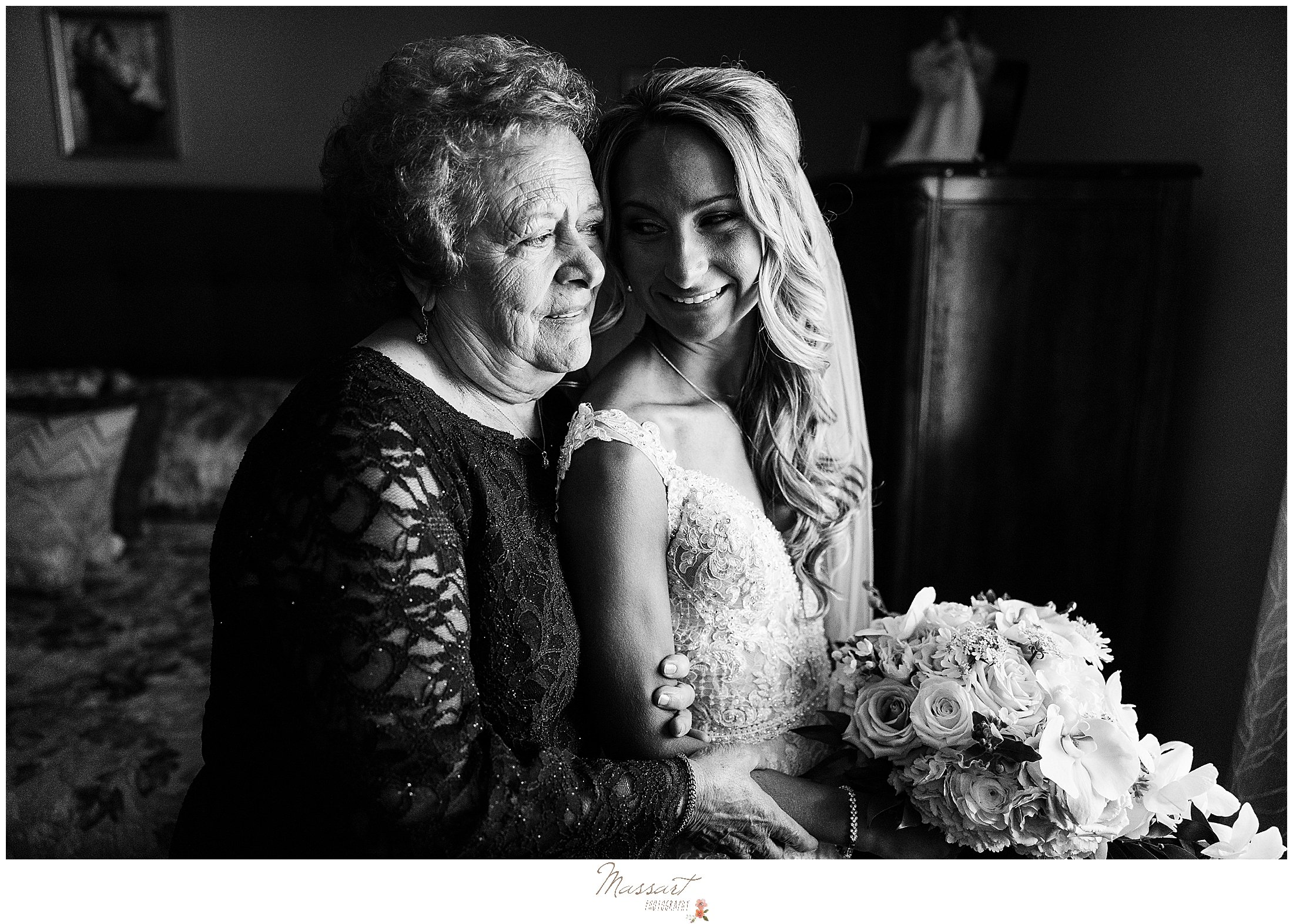 grandmother hugs bride during Graduate Hotel wedding prep