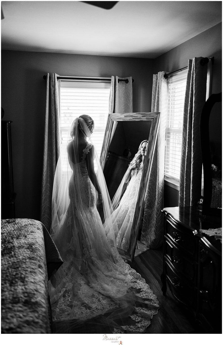 bride looks in mirror during prep